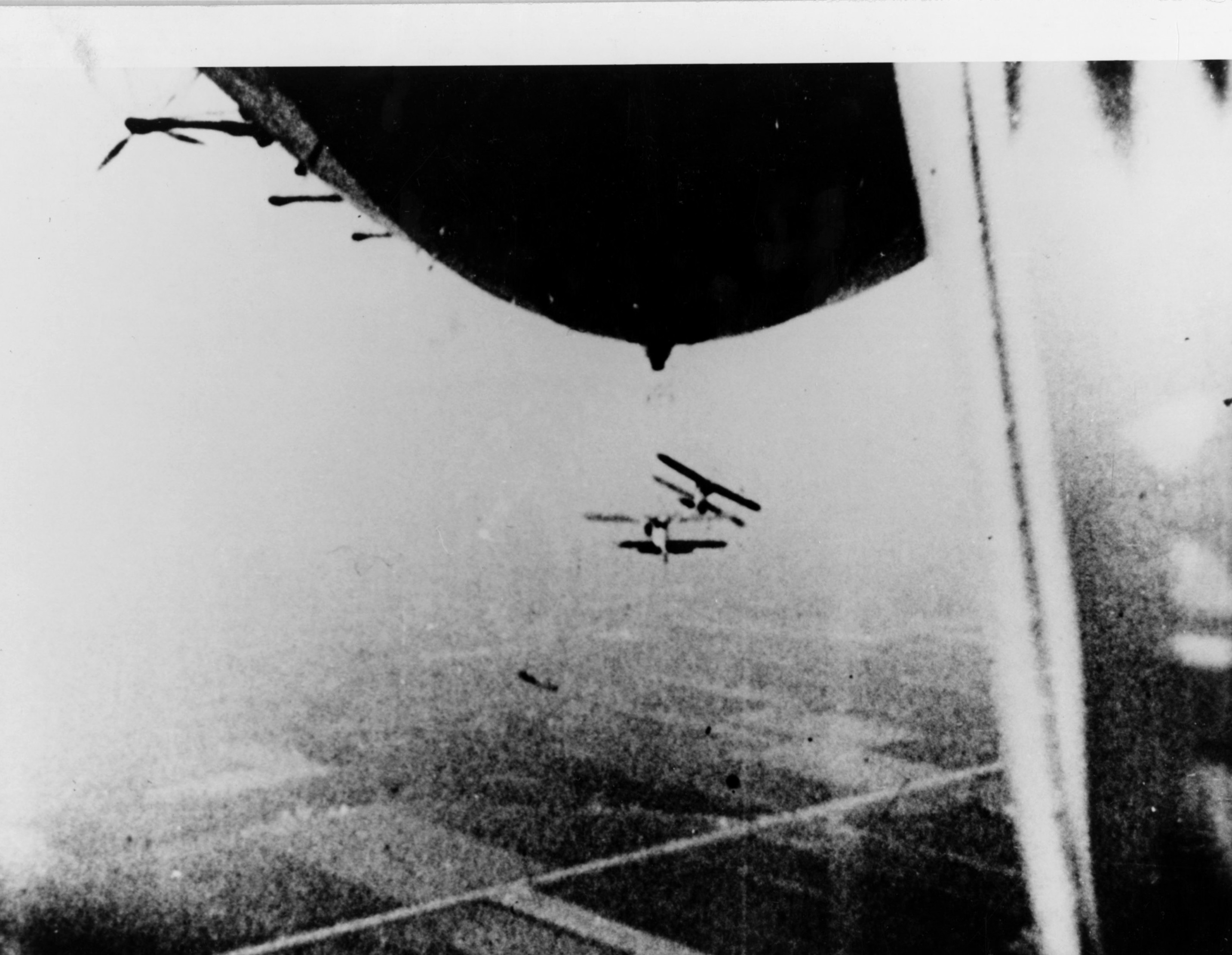 Two Curtiss F9C-2 Sparrowhawks drop simultaneously from USS Macon (ZRS-5) over Sunnyvale, Calif. in 1934.