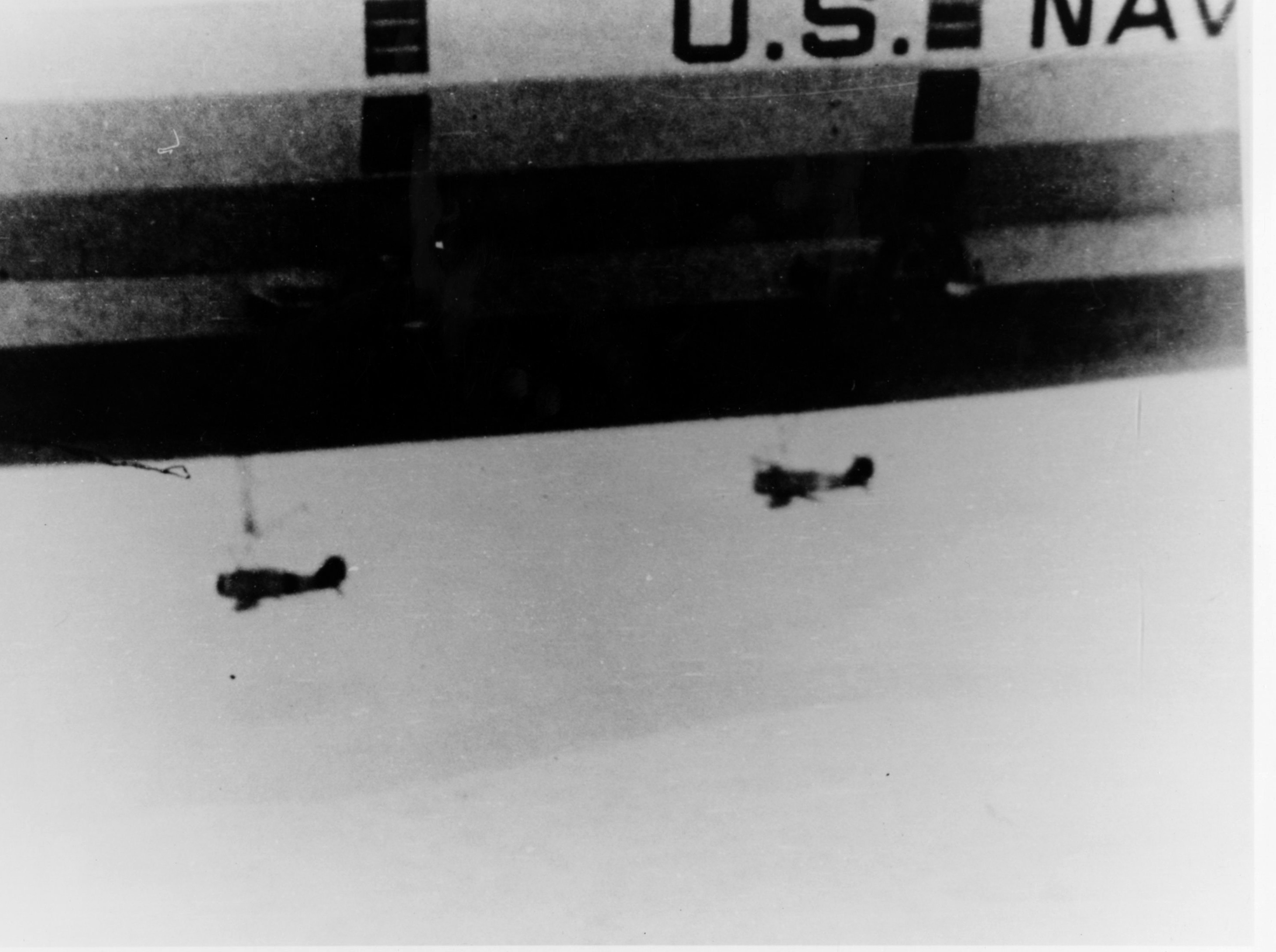 Two Curtiss F9C-2 Sparrowhawks, with landing gear removed, under USS Macon (ZRS-5) in 1934.