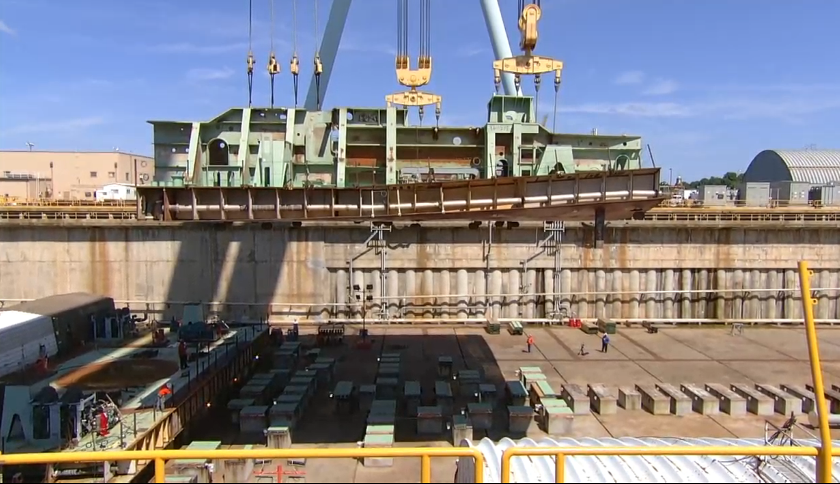 A screen grab of a Huntington Ingalls Industries' video of the keel laying of nuclear carrier John F. Kennedy (CVN-79). HII Image