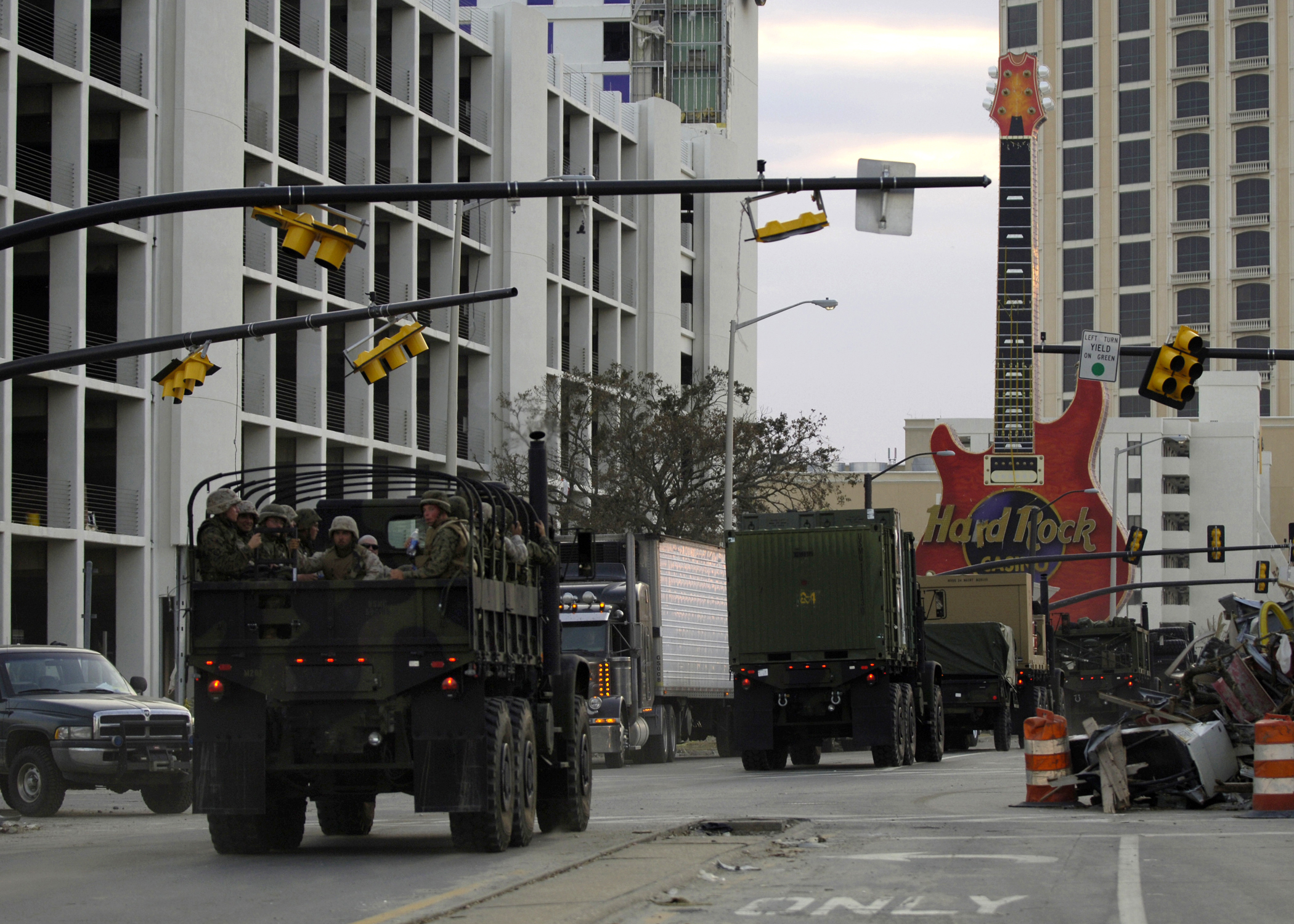 U.S. Marines Corps vehicles, assigned to the 24th Marine Expeditionary Unit, Service Support Group, travels through Biloxi, Miss., to assist the victims of Hurricane Katrina on Sept. 6, 2005. US Navy Photo
