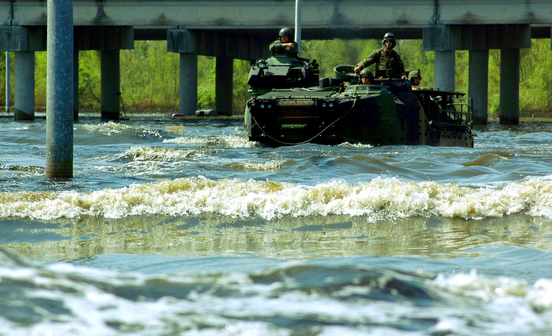 Marines aboard an Assault Amphibian Vehicle venture through waves and polluted water through the devastated neighborhoods around New Orleans looking for survivors of Hurricane Katrina. US Marine Corps Photo