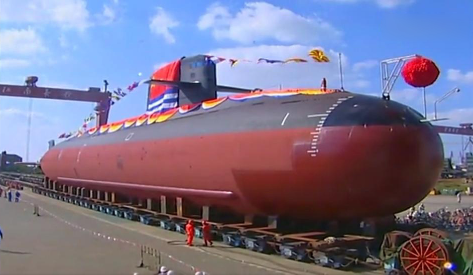 Type 039B Yuan-class submarine during rollout at the Jiangnan Shipyard on Changxing Island. Note the long white line in the draft markings, which designates the submarine's normal surface waterline. Also note the low-frequency passive flank array just above the keel blocks.