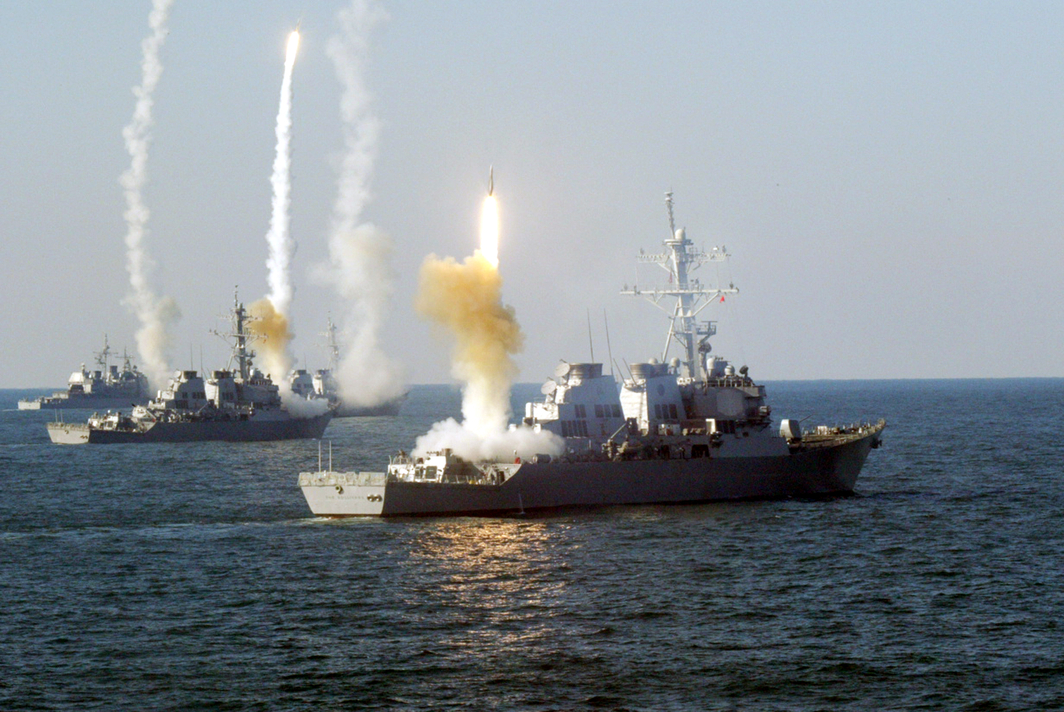 Left to right, the guided missile cruiser USS Vicksburg (CG 69), and the guided missile destroyers USS Roosevelt (DDG 80), USS Carney (DDG 64) and USS The Sullivans (DDG 68) launch a coordinated volley of missiles in 2003. US Navy Photo