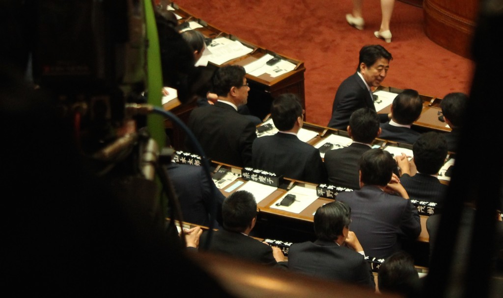Japanese Prime Minister Shinzo Abe, seated at the front row of the National Diet's Assembly Hall.