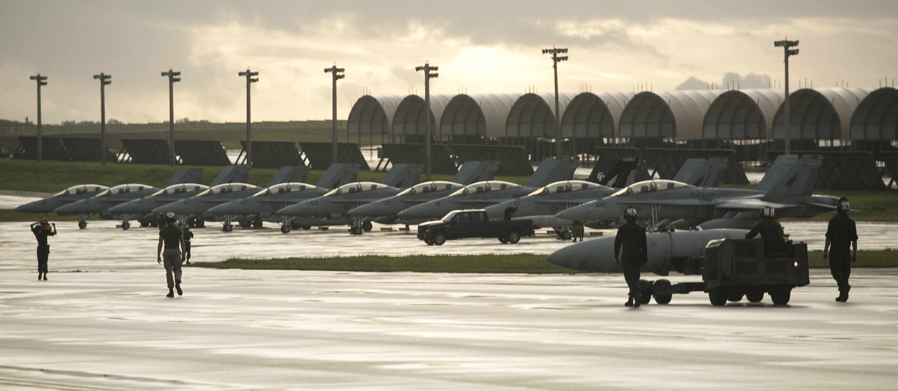 Aircraft maintenance Marines make their way to conduct maintenance procedures on aircraft during a maintenance-focused exercise in October 2014. US Marine Corps photo.