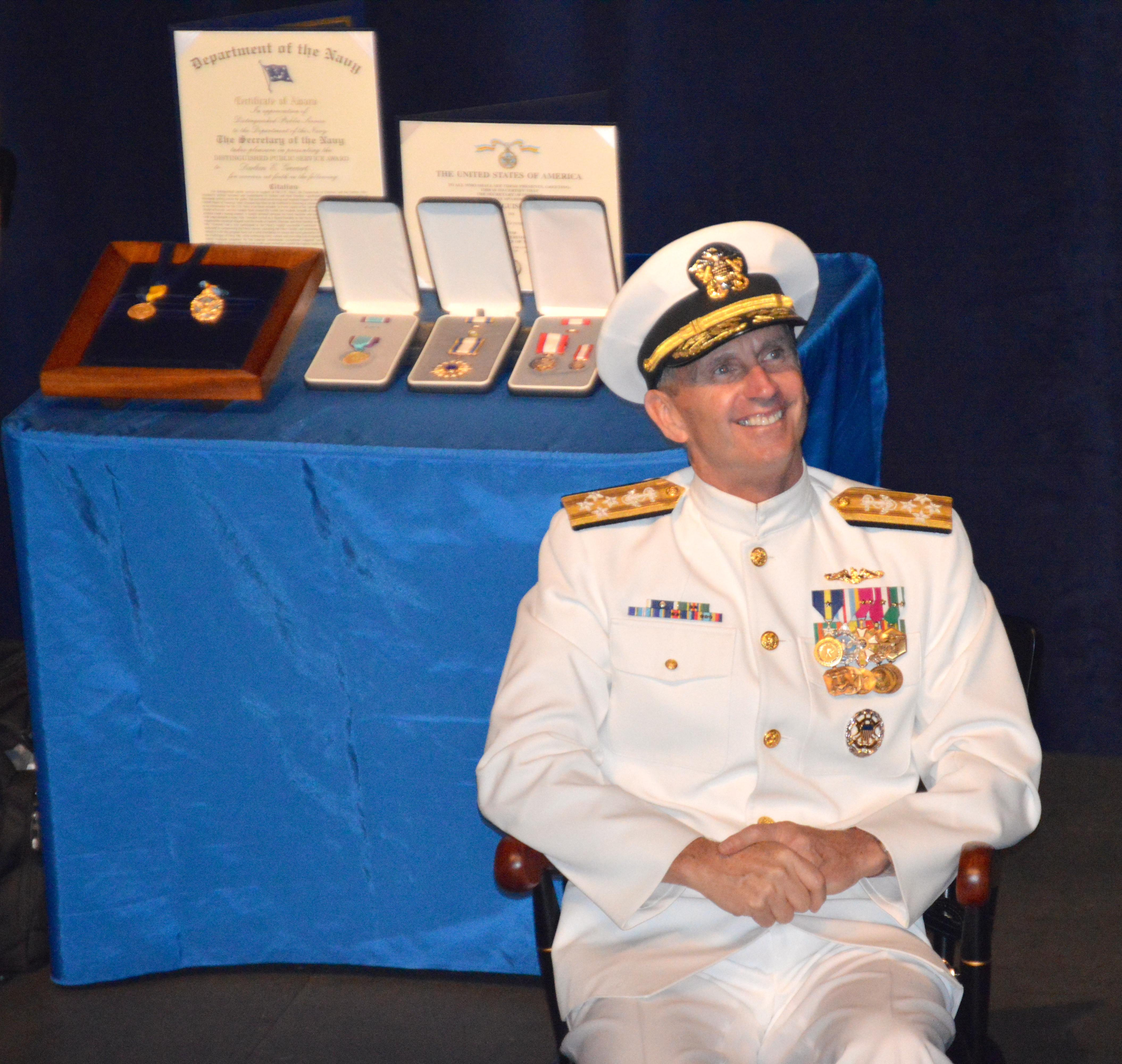 Adm. Jonathan Greenert listens as Navy Secretary Ray Mabus jokes about his time as a midshipman during the chief of naval operations change of command ceremony Sept. 18 at the U.S. Naval Academy. USNI News photo.