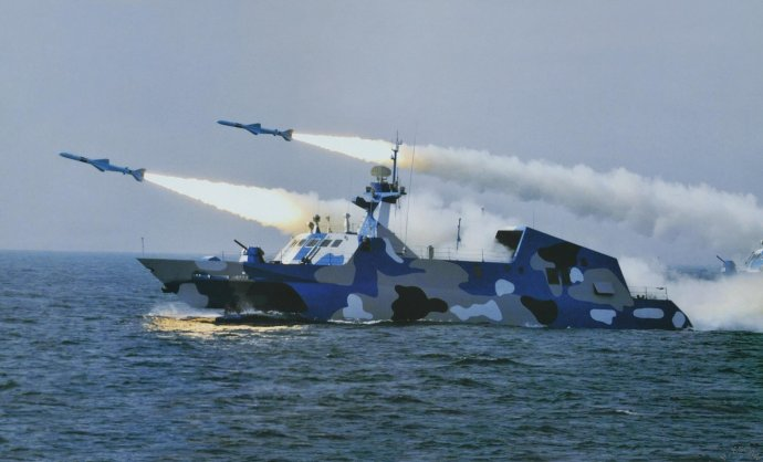 Type 022 Fast Attack Missile Craft Houbei Class of the People's Liberation Army Navy (PLA Navy) test fires C-803 antiship missile. PLAN Photo via Global Military Review