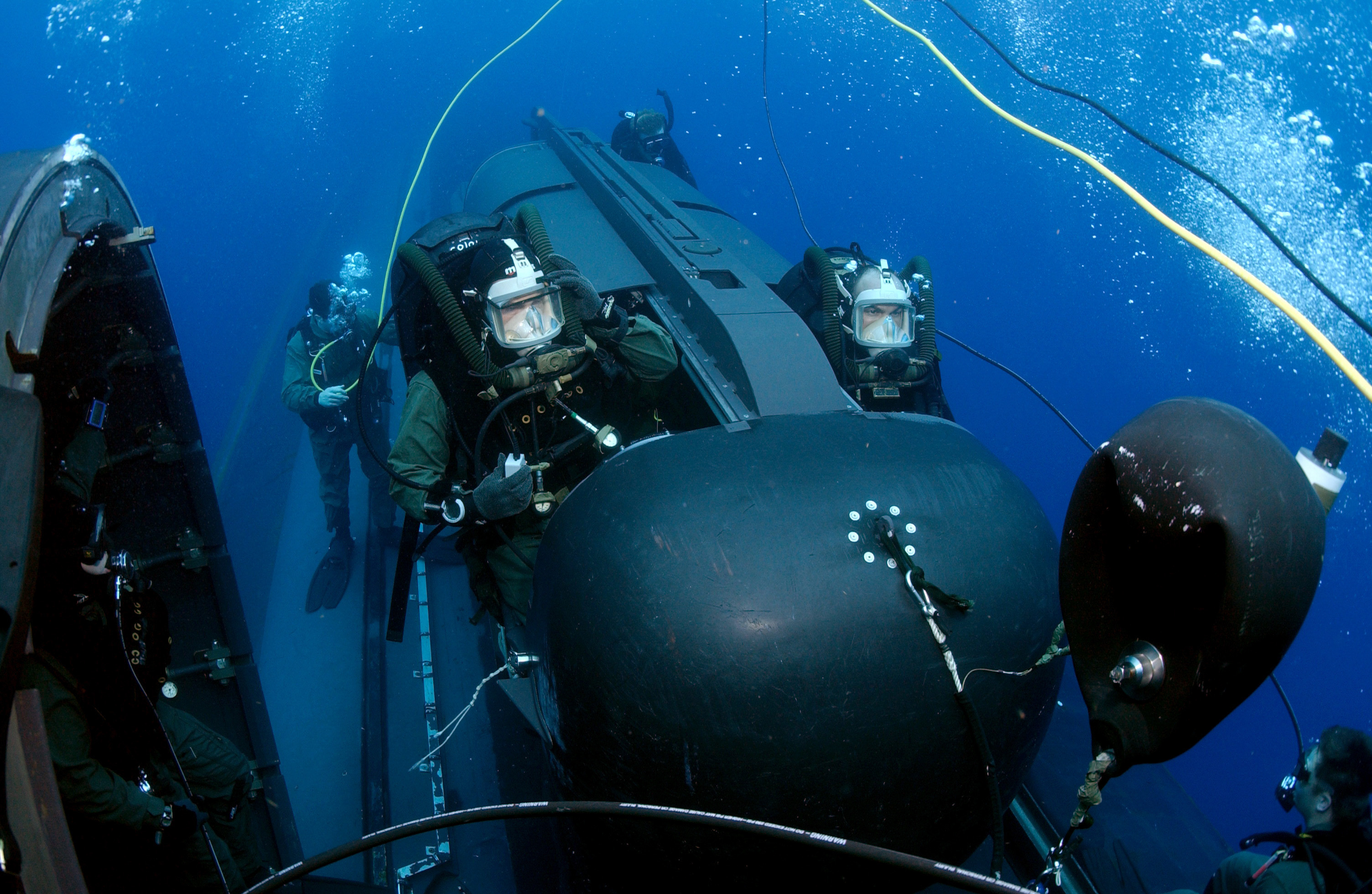 Members of SEAL Delivery Vehicle Team Two (SDVT-2) prepare to launch one of the team's SEAL Delivery Vehicles (SDV) from the back of the Los Angeles-class attack submarine USS Philadelphia (SSN 690) on a training exercise in May 2005. US Navy photo.