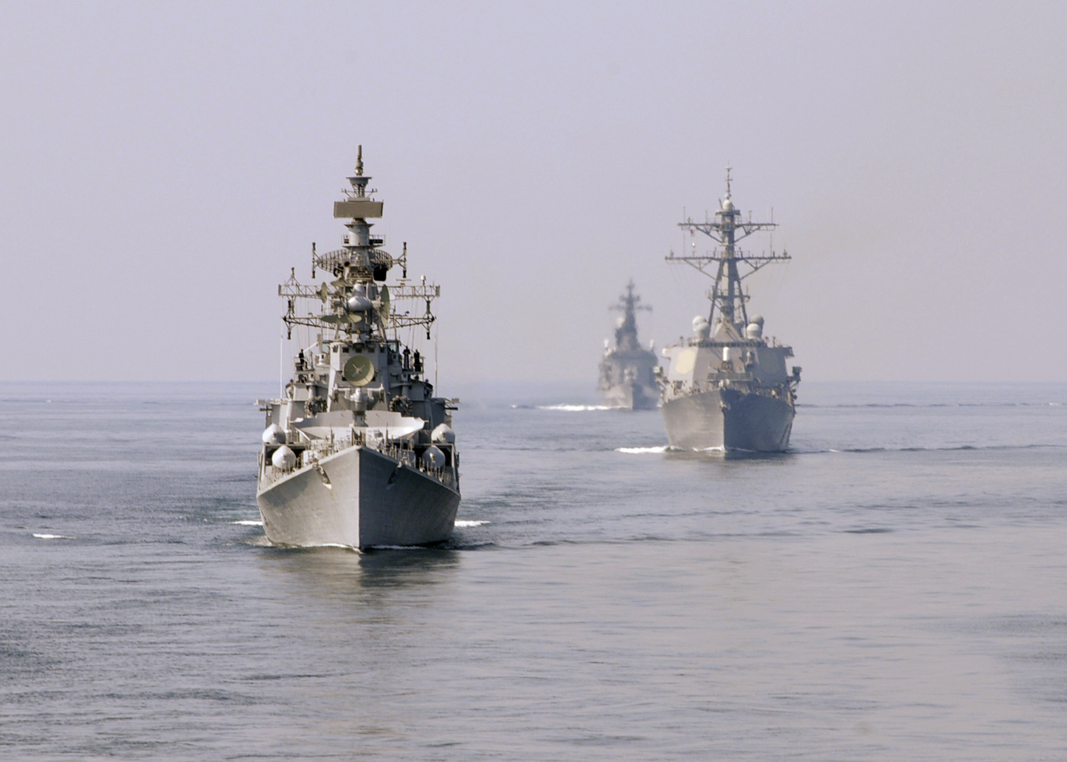 The Indian Navy guided-missile destroyer INS Ranvir (DDG-54), left, the Arleigh-Burke class guided-missile destroyer USS Fitzgerald (DDG-62), and the Japan Maritime Self-Defense Force destroyer JDS Kurama (DDH-144) are underway during Exercise Malabar 2009, an annual exercise led by the Indian Navy. US Navy photo.