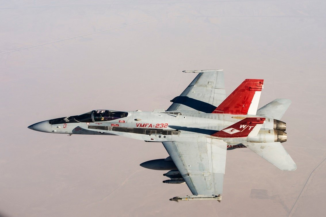 U.S. Marine Corps F/A-18s with Marine Fighter Attack Squadron 232 over the skies of Iraq on July 19, 2015. The 'Red Devils' of VMFA-232 are currently deployed with the Special Purpose Marine Air Ground Task Force-Crisis Response-Central Command and provide offensive strike and close air support to Operation Inherent Resolve. US Marine Corps Photo