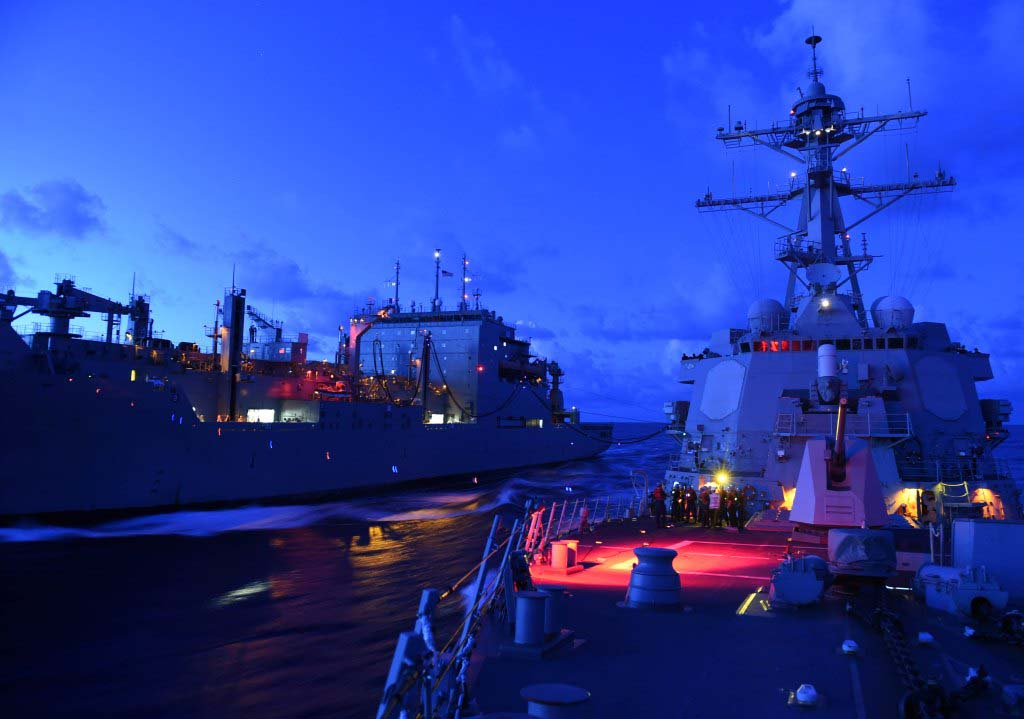 Steaming in the South China Sea USS Lassen (DDG-82), right, receives fuel from the Military Sealift Command dry cargo and ammunition ship USNS Amelia Earhart (T-AKE 6) during an underway replenishment. US Navy Photo