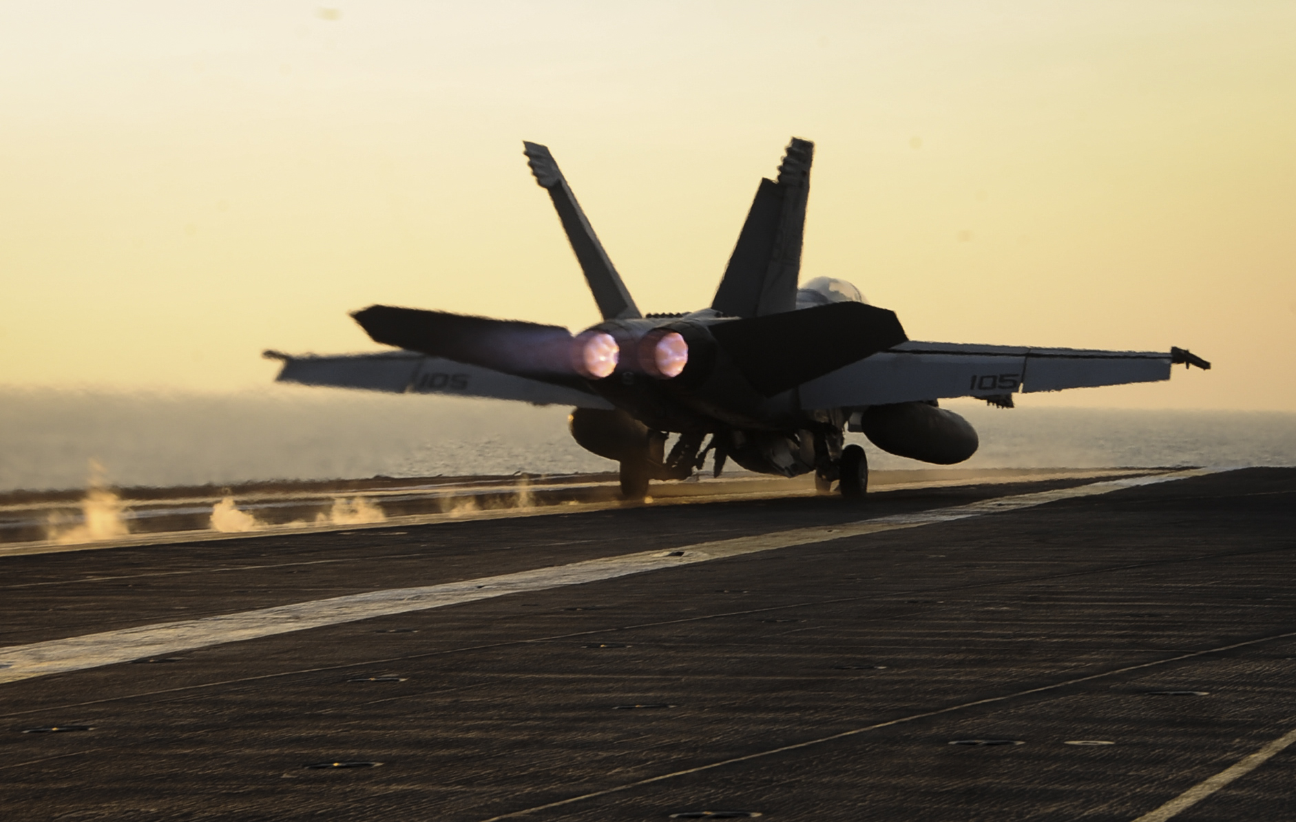 An F/A-18F Super Hornet assigned to the Red Rippers of Strike Fighter Squadron (VFA) 11 launches from the flight deck of the aircraft carrier USS Theodore Roosevelt (CVN 71) on Oct. 10, 2015 in support of operations against the Islamic State of Iraq and Syria. US Navy photo.