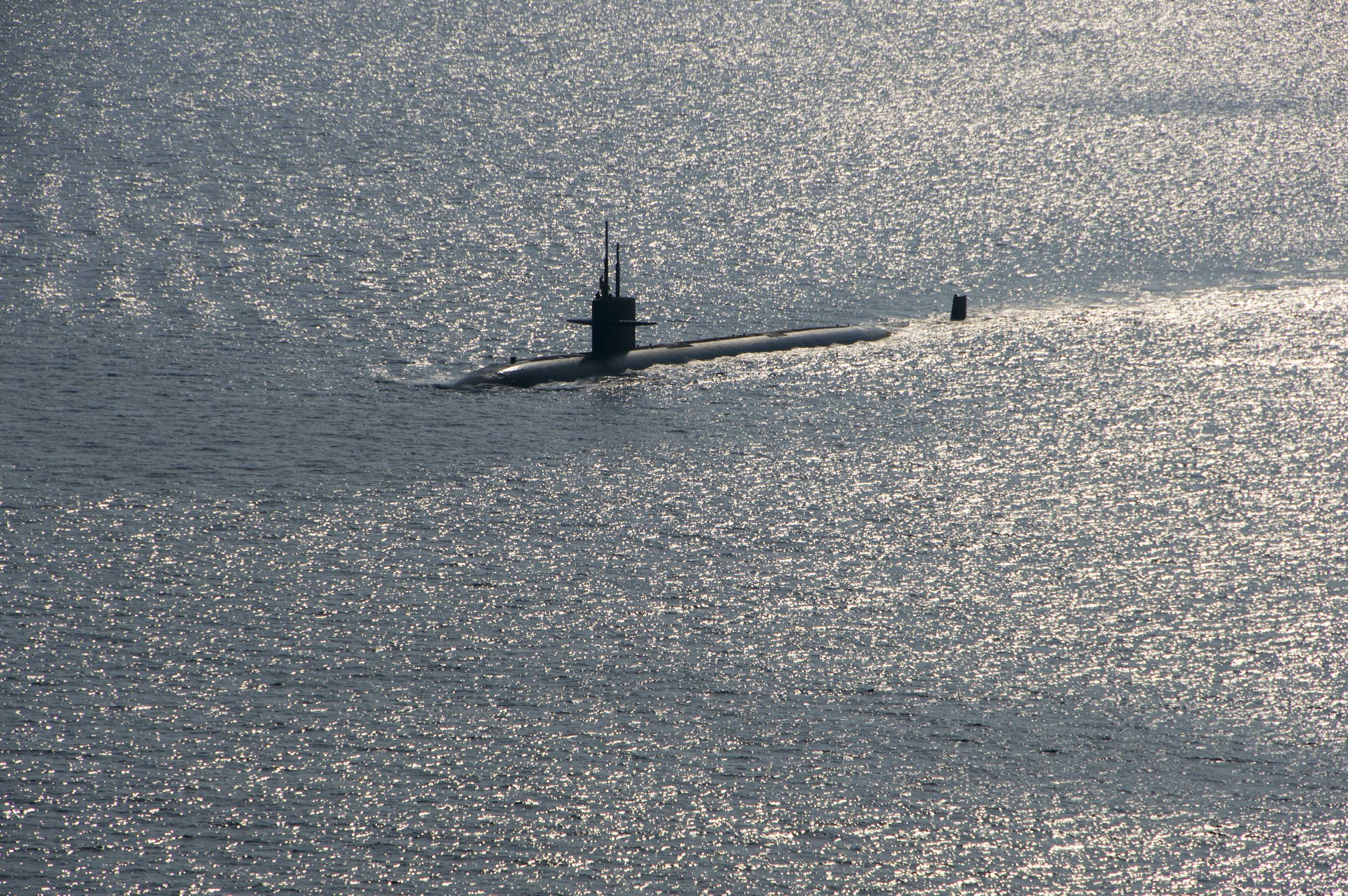 The Los Angeles-class attack submarine USS City of Corpus Christi (SSN-705) transits into formation during a photo exercise as a part of Exercise Malabar 2015 on Oct. 16, 2015. US Navy Photo