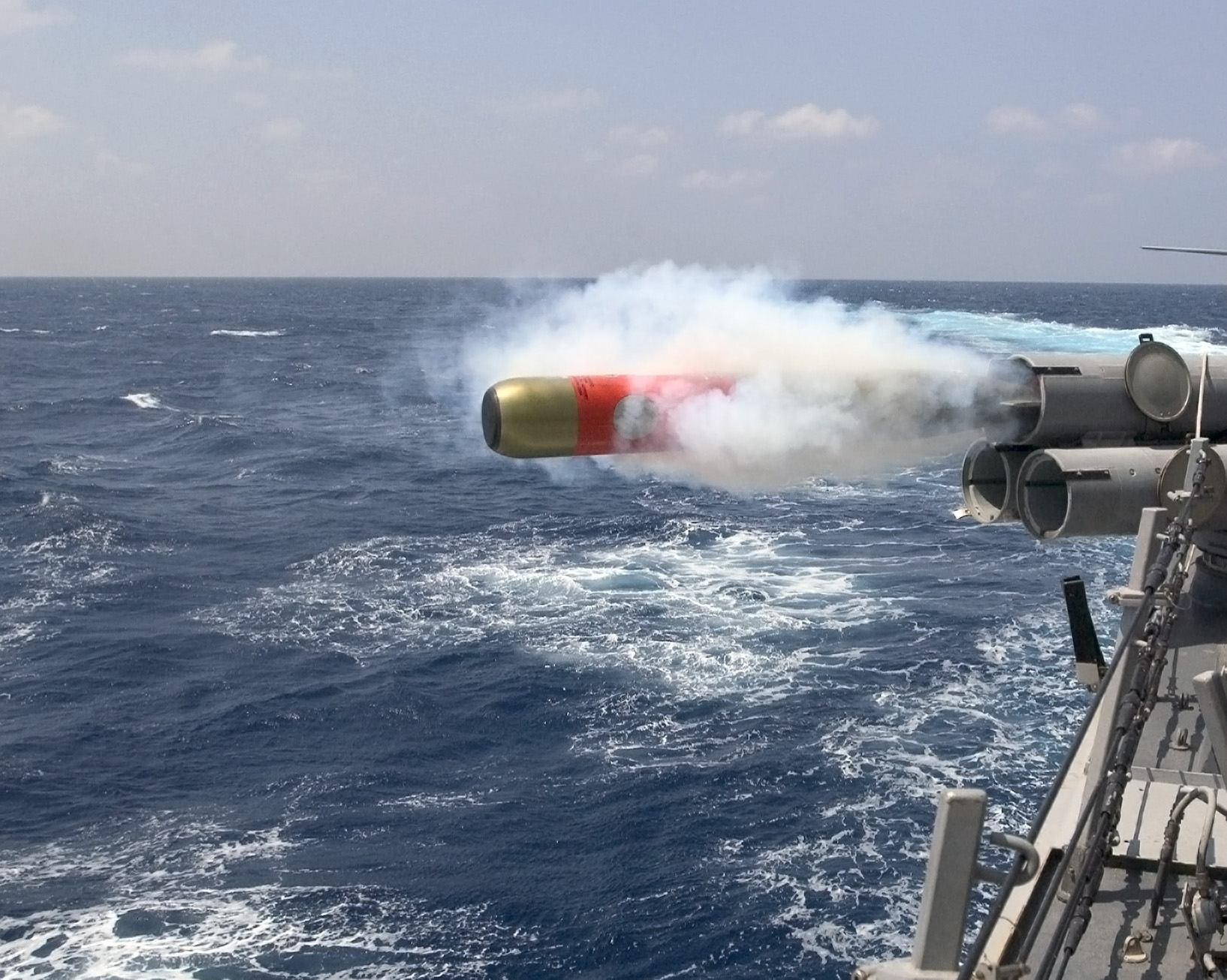 A MK-46 exercise torpedo is launched from the deck of Arleigh Burke class guided-missile destroyer USS Mustin (DDG-89) in 2007. US Navy Photo