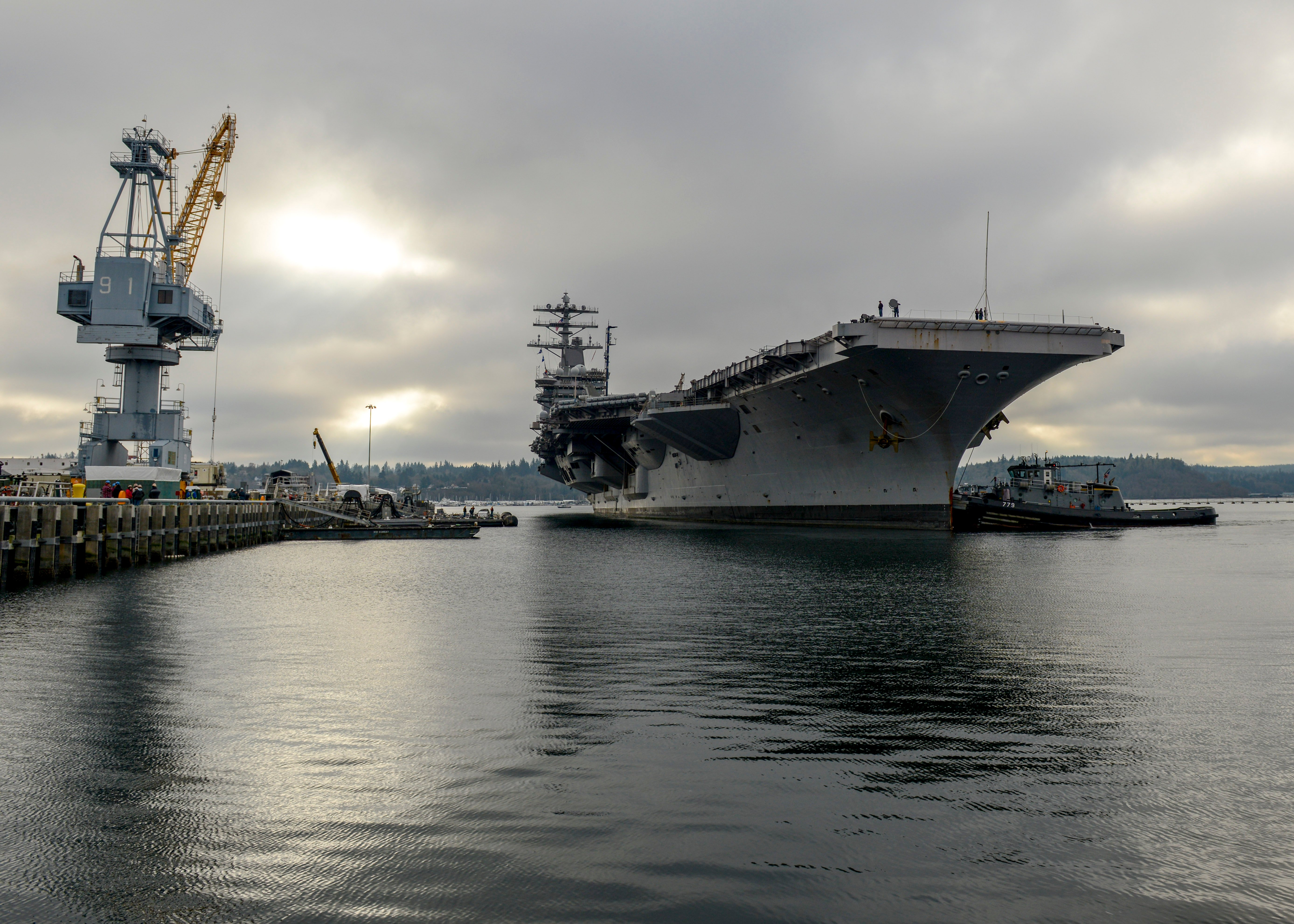 The Nimitz-class aircraft carrier USS Nimitz (CVN 68) arrives pierside at Naval Base Kitsap Bremerton prior to a planned incremental availability at Puget Sound Naval Shipyard and Intermediate Maintenance Facility. US Navy photo.