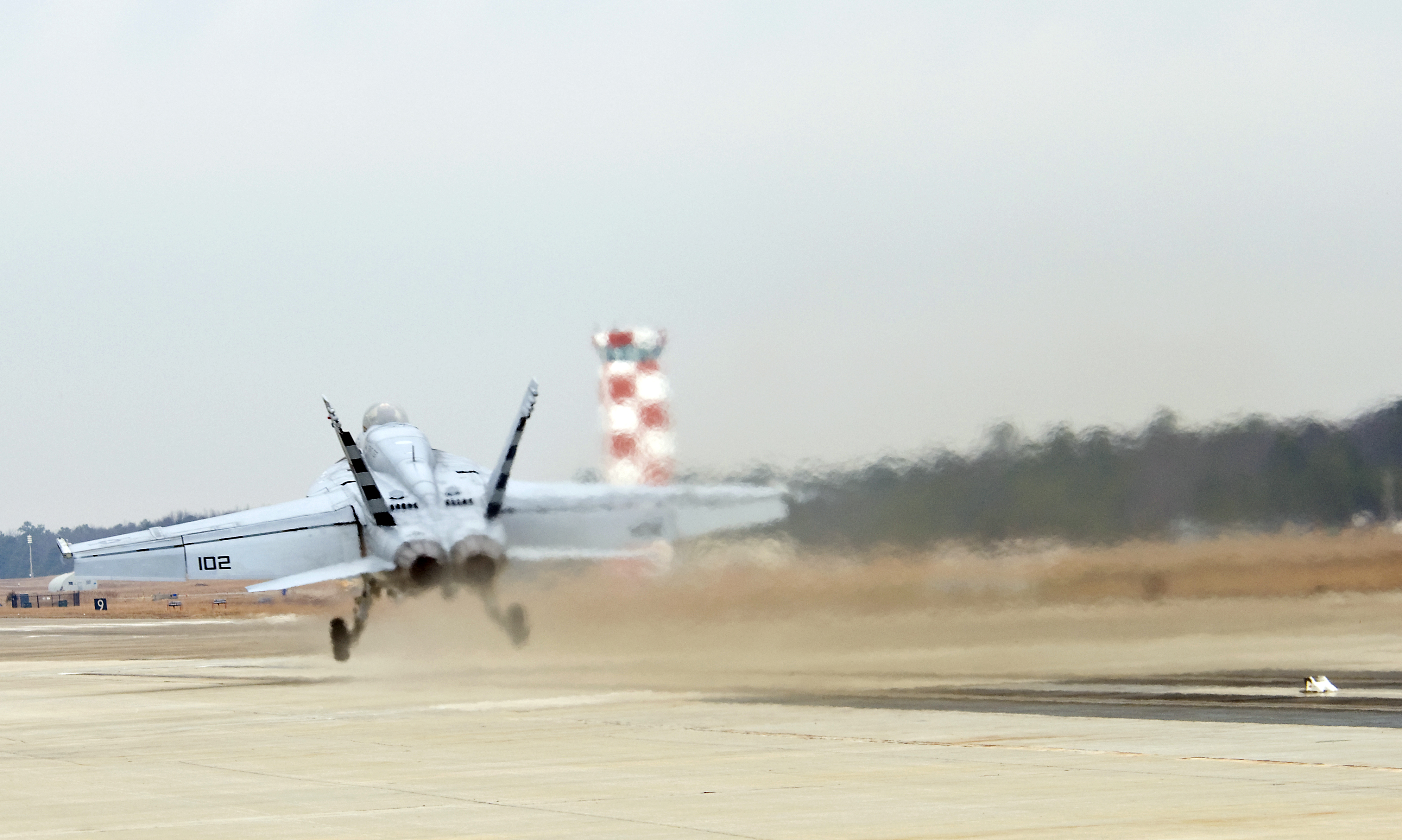 Many of the Ford-class carriers' systems, including the Dual Band Radar, Electromagnetic Aircraft Launch System and Advanced Arresting Gear, were designed and delivered as government-furnished equipment. Above, an F/A-18E Super Hornet is launched during a test of the EMALS in Lakehurst, N.J., in 2010. US Navy photo.