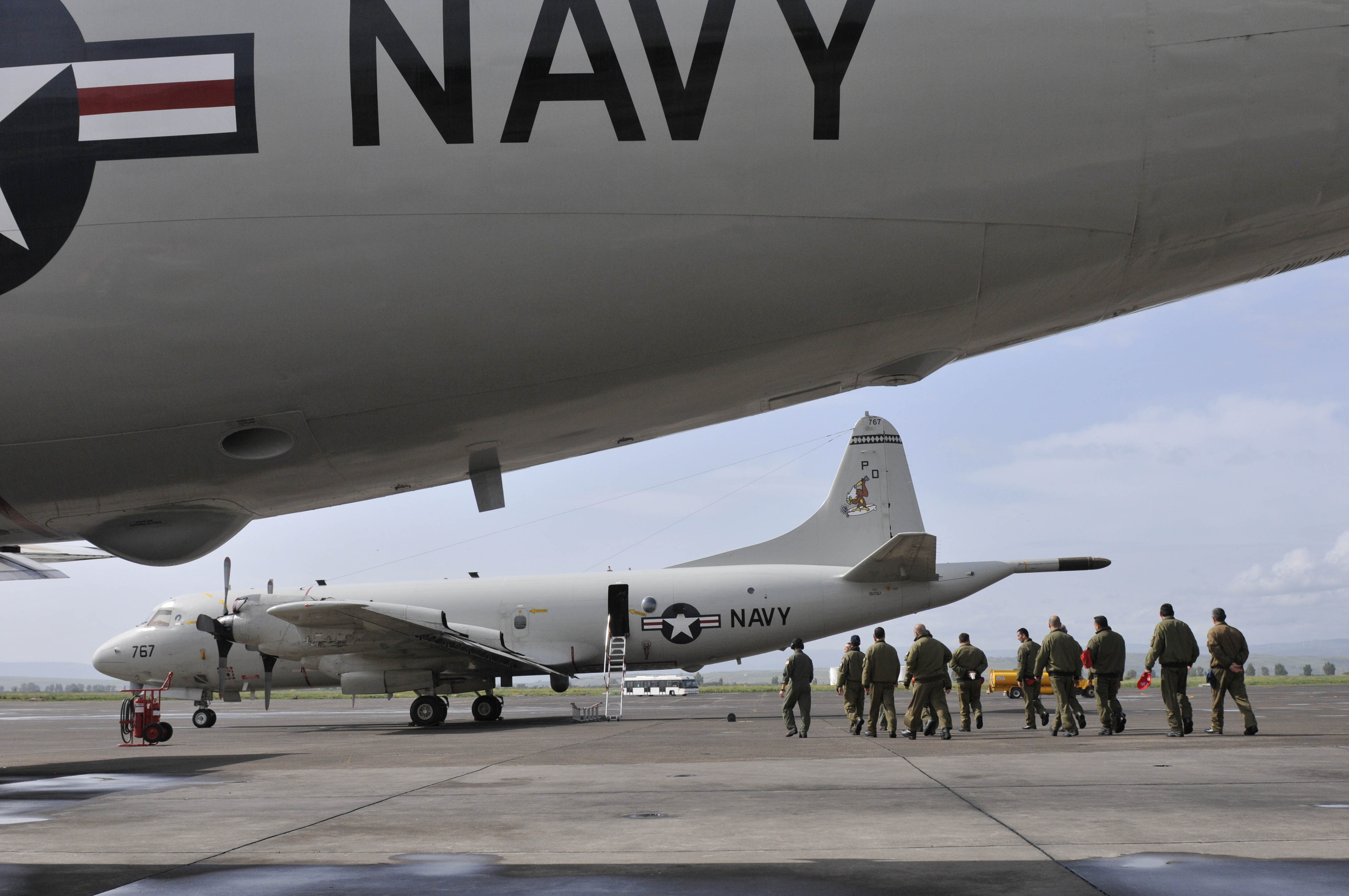 Italian officers from Naval Air Station Sigonella prepare to board a P-3C Orion maritime patrol aircraft on April, 22, 2014. US Navy Photo