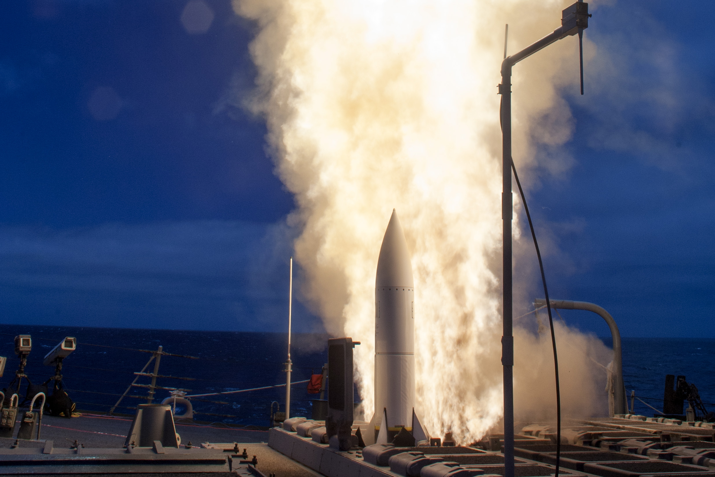 The Arleigh-Burke class guided-missile destroyer USS John Paul Jones (DDG 53) launches a Standard Missile 6 (SM-6) during a live-fire test of the ship's Aegis Weapons System in June 2014. US Navy photo.