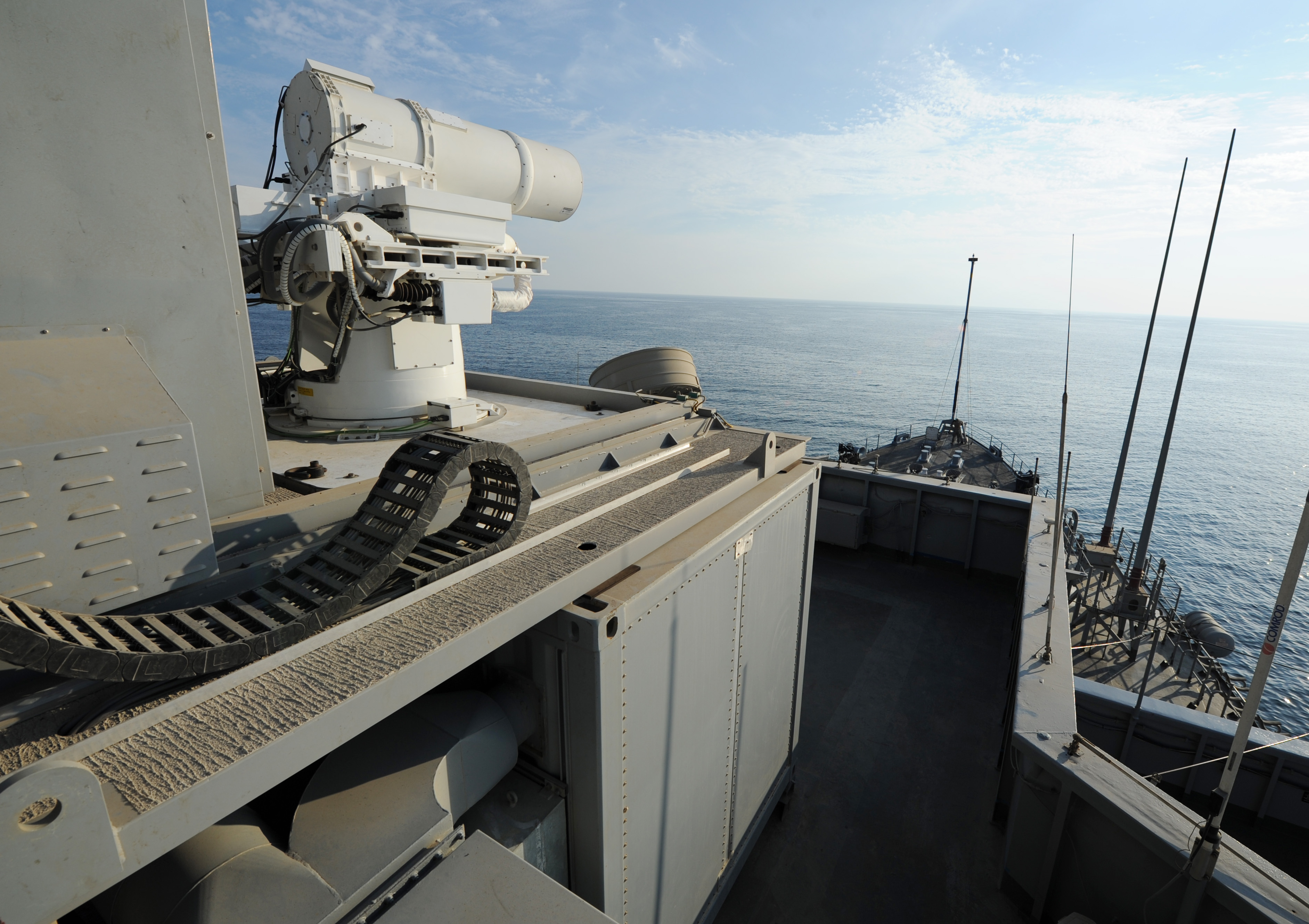 The Afloat Forward Staging Base (Interim) USS Ponce (ASB(I) 15) conducts an operational demonstration of the Office of Naval Research (ONR)-sponsored Laser Weapon System (LaWS) while deployed to the Arabian Gulf on Nov. 16, 2014. US Navy photo.