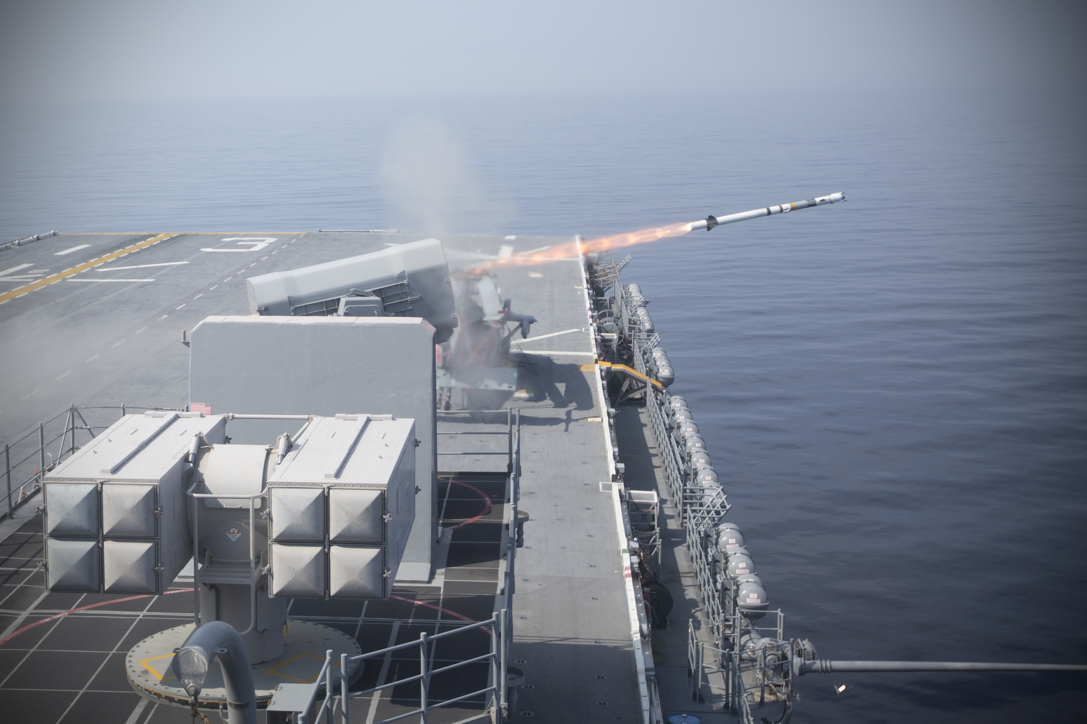 The amphibious assault ship USS Kearsarge (LHD 3) fires a rolling airframe missile during a missile exercise on June 14, 2015. US Navy photo.