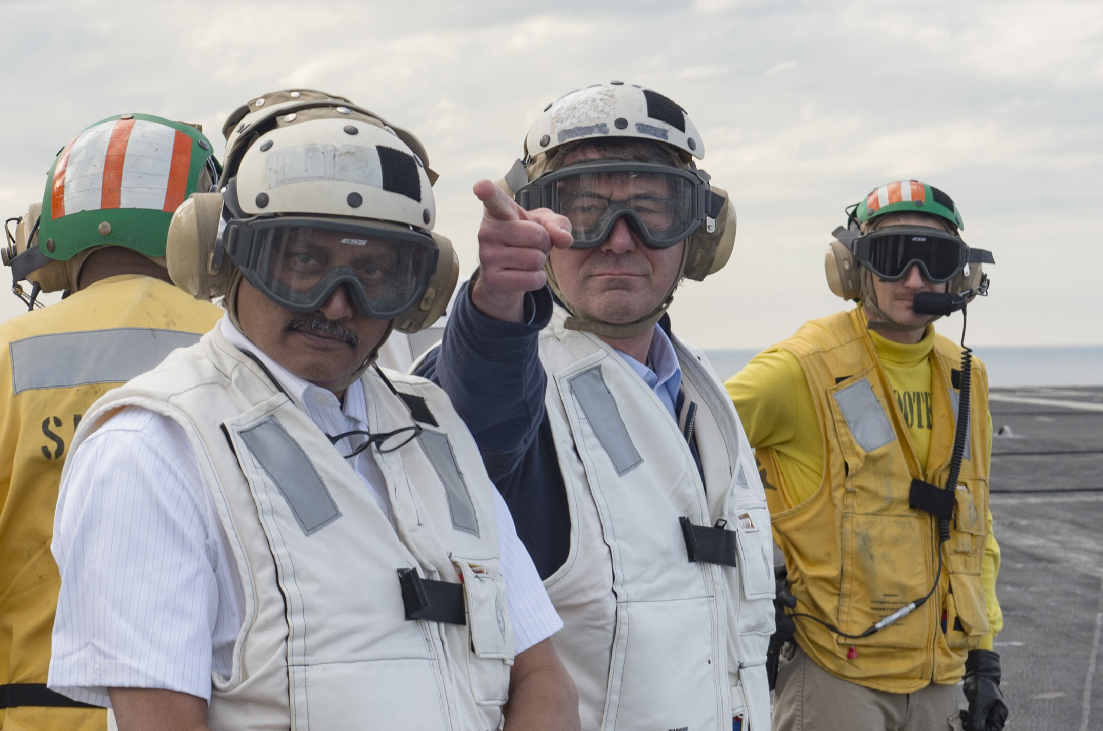 Indian Minister of Defense Manohar Parrikar (left) and Secretary of Defense Ash Carter (center) observe flight operations on USS Dwight D. Eisenhower (CVN-69). US Navy Photo