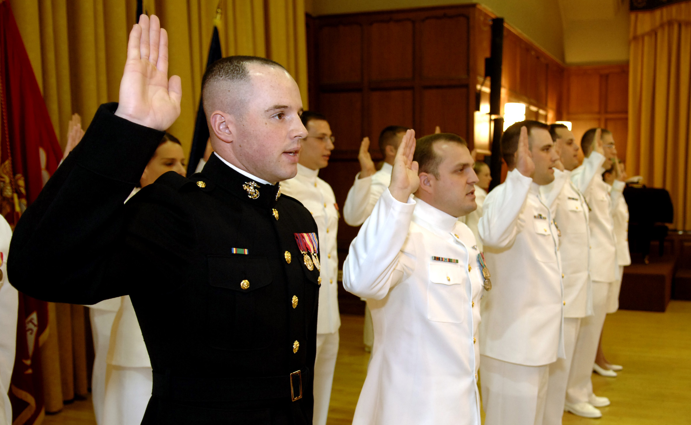 2nd Lt. Mike White, recites the oath of office from then Secretary of the Navy (SECNAV), the Honorable Dr. Donald C. Winter during a commissioning ceremony in 2007. US Navy Photo