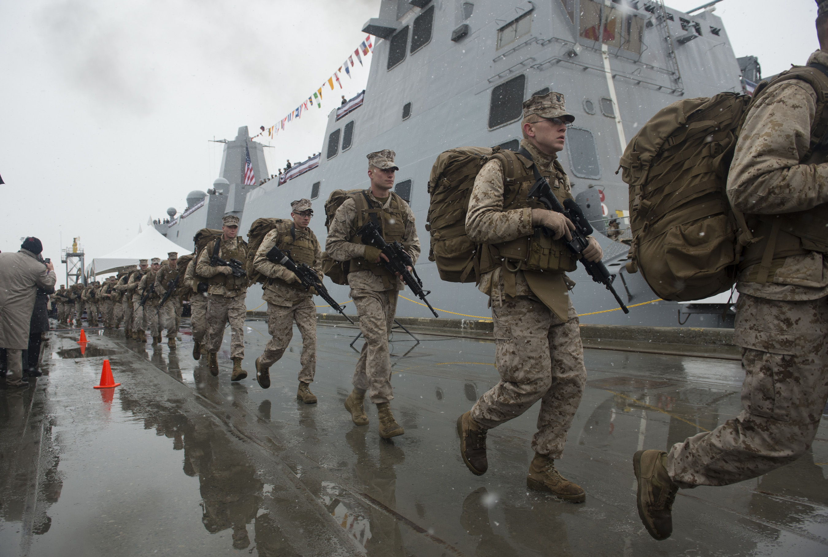 130504-N-DR144-818 ANCHORAGE, Alaska (May 4, 2013) Marines assigned to Task Force Denali run to bring the ship to life during the commissioning of the San Antonio-class amphibious transport dock ship USS Anchorage (LPD 23) at the Port of Anchorage. More than 4,000 people gathered to witness the ship's commissioning in its namesake city of Anchorage, Alaska. Anchorage, the seventh San Antonio-class LPD, is the second ship to be named for the city and the first U.S. Navy ship to be commissioned in Alaska. (U.S. Navy photo by Mass Communication Specialist 1st Class James R. Evans/Released)