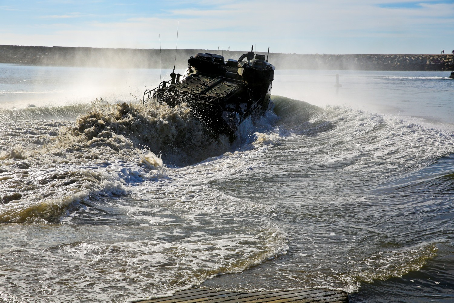 An AAV-7 Assault Amphibious Vehicle goes into the water while conducting a splash demonstration during Exercise Iron Fist 2014 at Camp Pendleton, Calif. US Marine Corps Photo