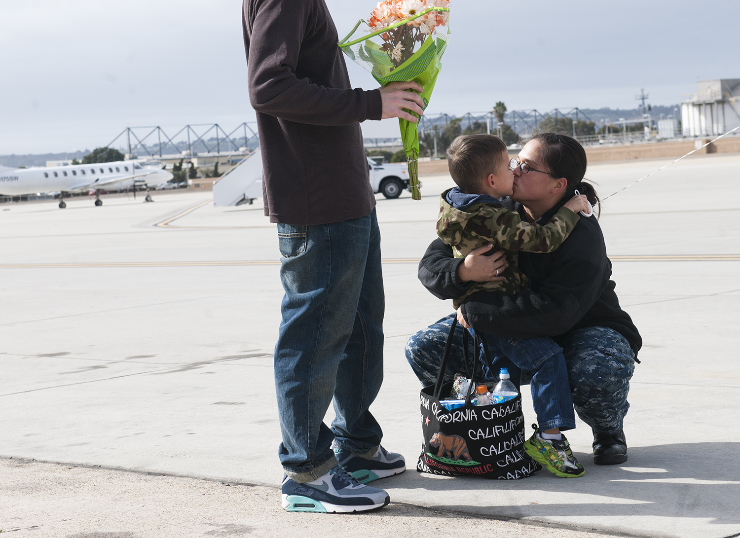 Electronics Technician 2nd Class Reane Clark greets her son after returning home from a deployment around South America. US Navy Photo