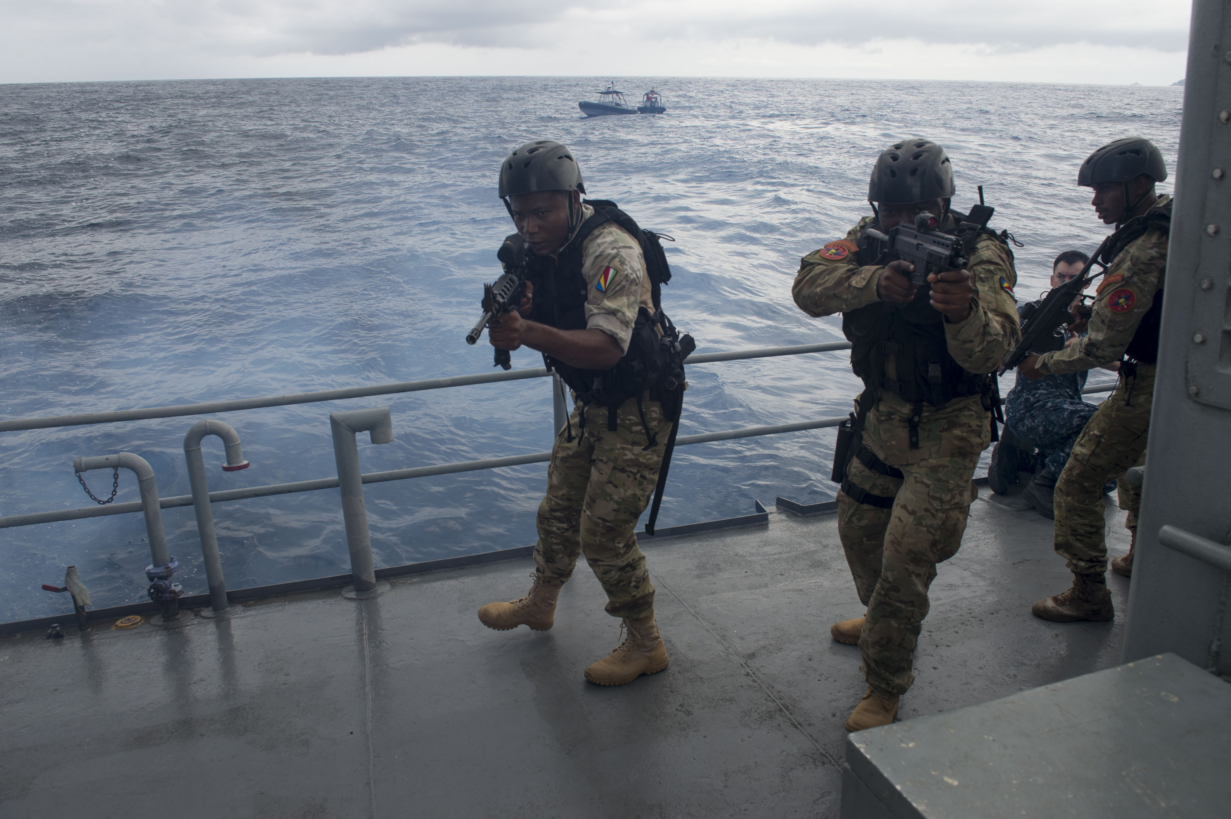 Maritime forces from Seychelles conduct a visit, board, search and seizure drill on a Seychellois patrol boat during exercise Cutlass Express 2016 on Feb 2. US Navy photo.