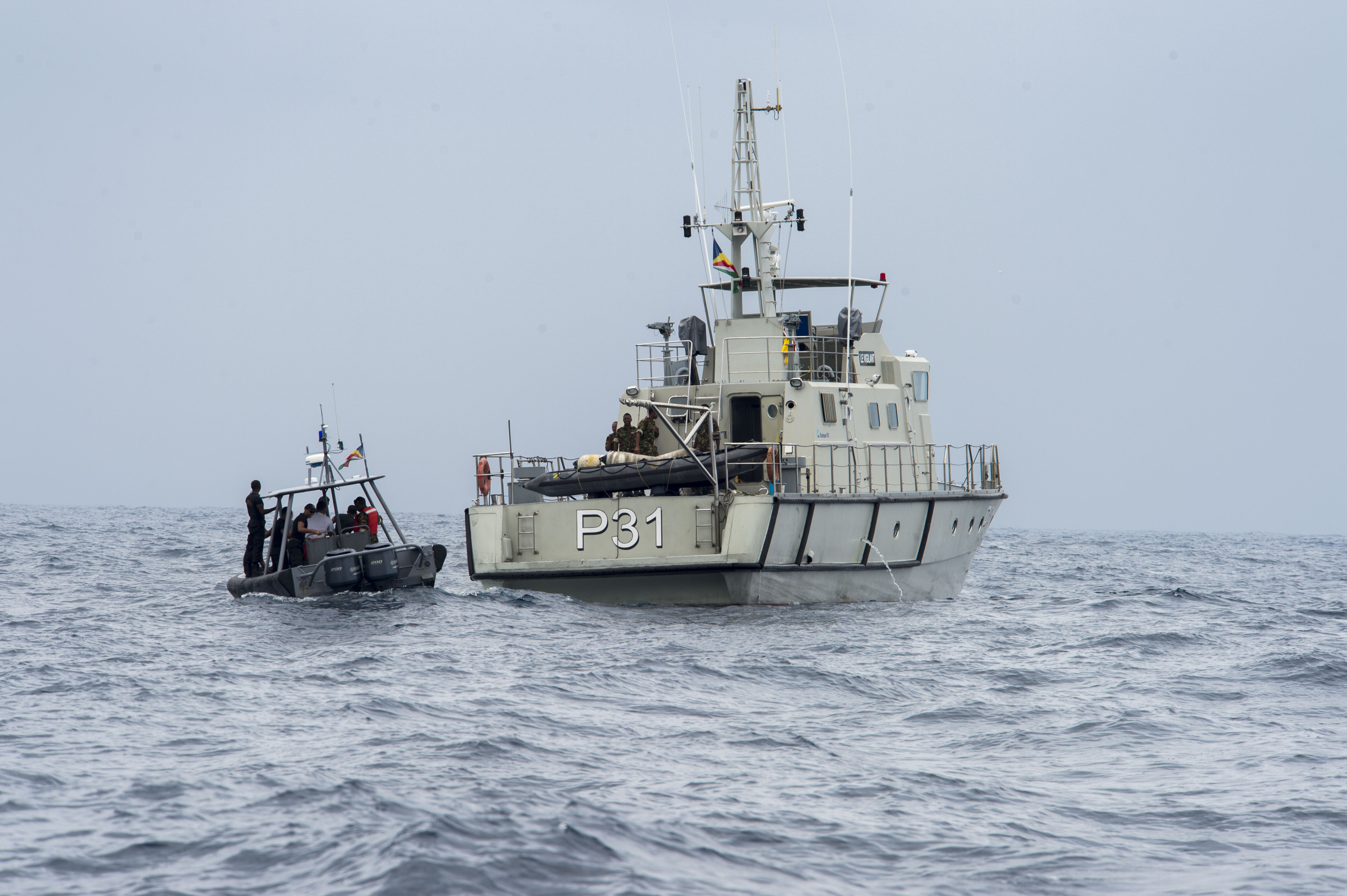 Maritime forces from Seychelles pilot a rigid hull inflatable boat (RHIB) filled with Mauritian Coast Guardsmen to a Seychellois patrol boat to conduct a visit, board search and seizure exercise during exercise Cutlass Express 2016 on Feb 2. US Navy photo.