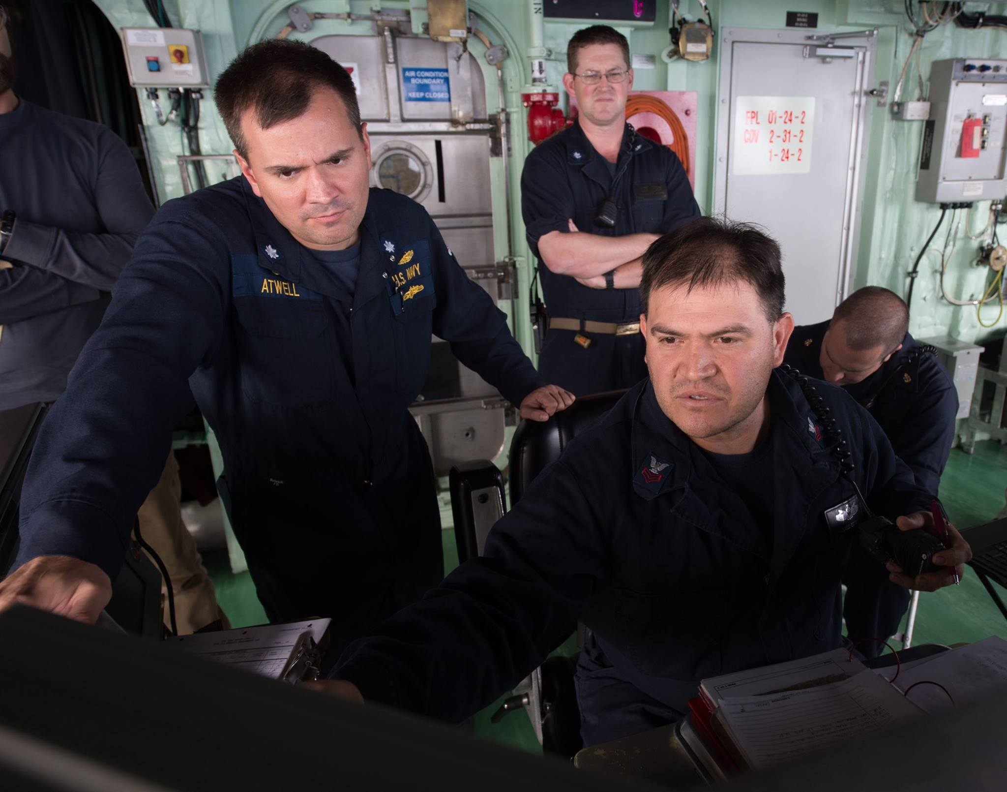 Cmdr. Michael Atwell, commanding officer of LCS Crew 101, observes Engineman 1st Class Silvano Becerra make the necessary engineering adjustments for USS Fort Worth (LCS 3) to operate at high speeds in response to a man overboard reported by a merchant vessel in the South China Sea in late 2015. US Navy Photo