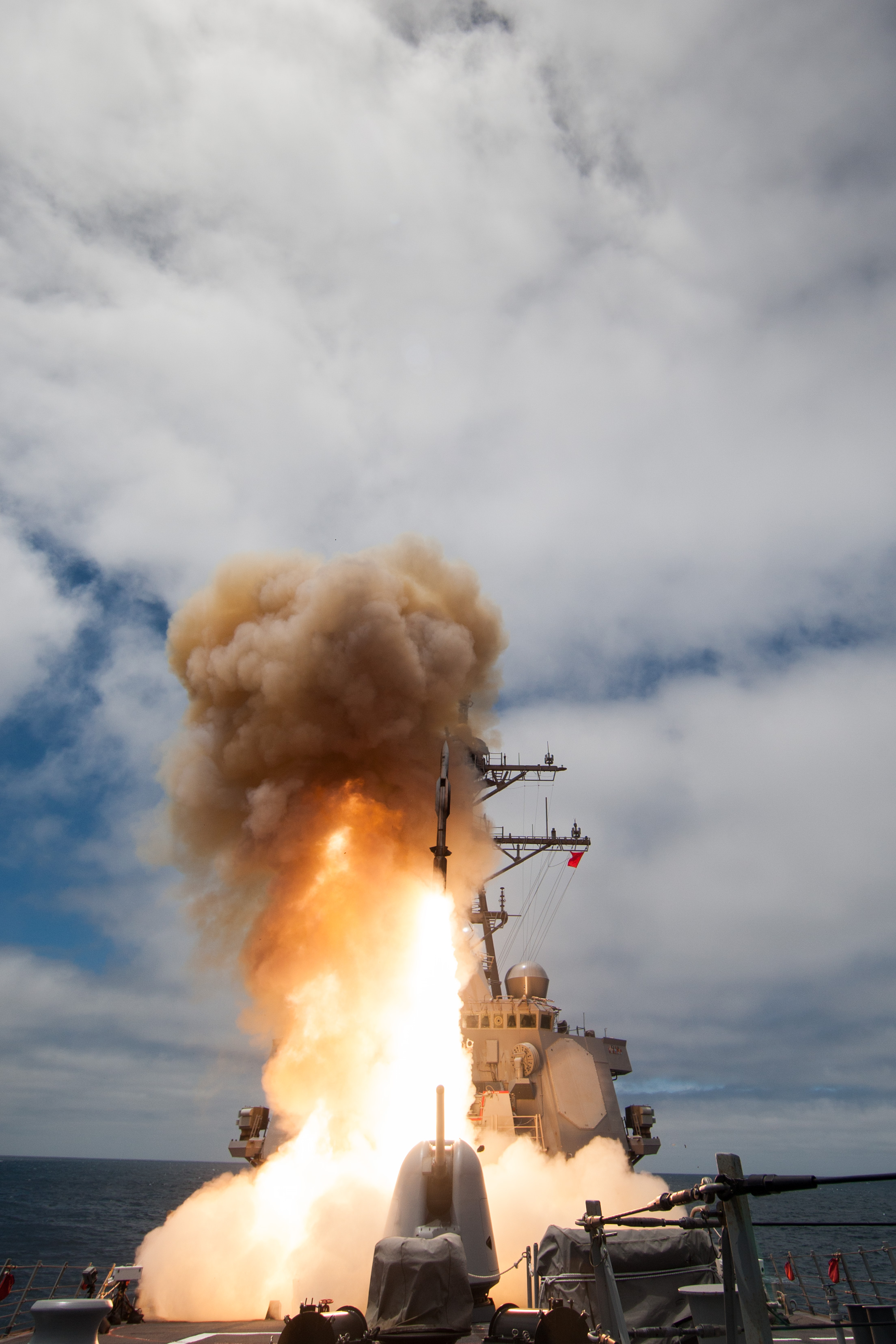 The Arleigh-Burke class guided-missile destroyer USS John Paul Jones (DDG 53) launches a Standard Missile-6 (SM-6) during a live-fire test of the ship's Aegis weapons system in June 2014. US Navy photo.
