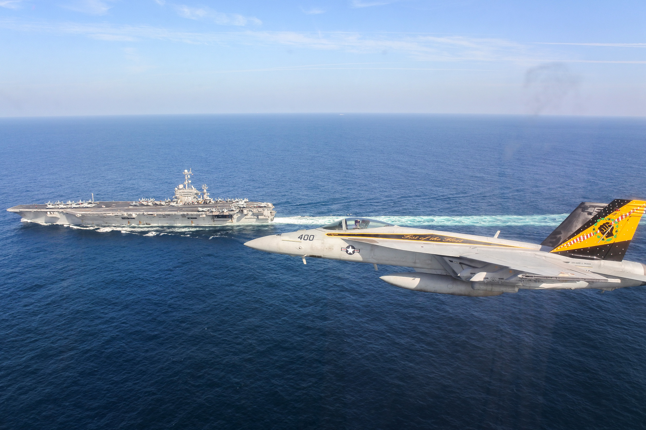 A F/A-18E Super Hornet over the Gulf of Oman near the aircraft carrier USS Harry S. Truman (CVN-75). US Navy Photo