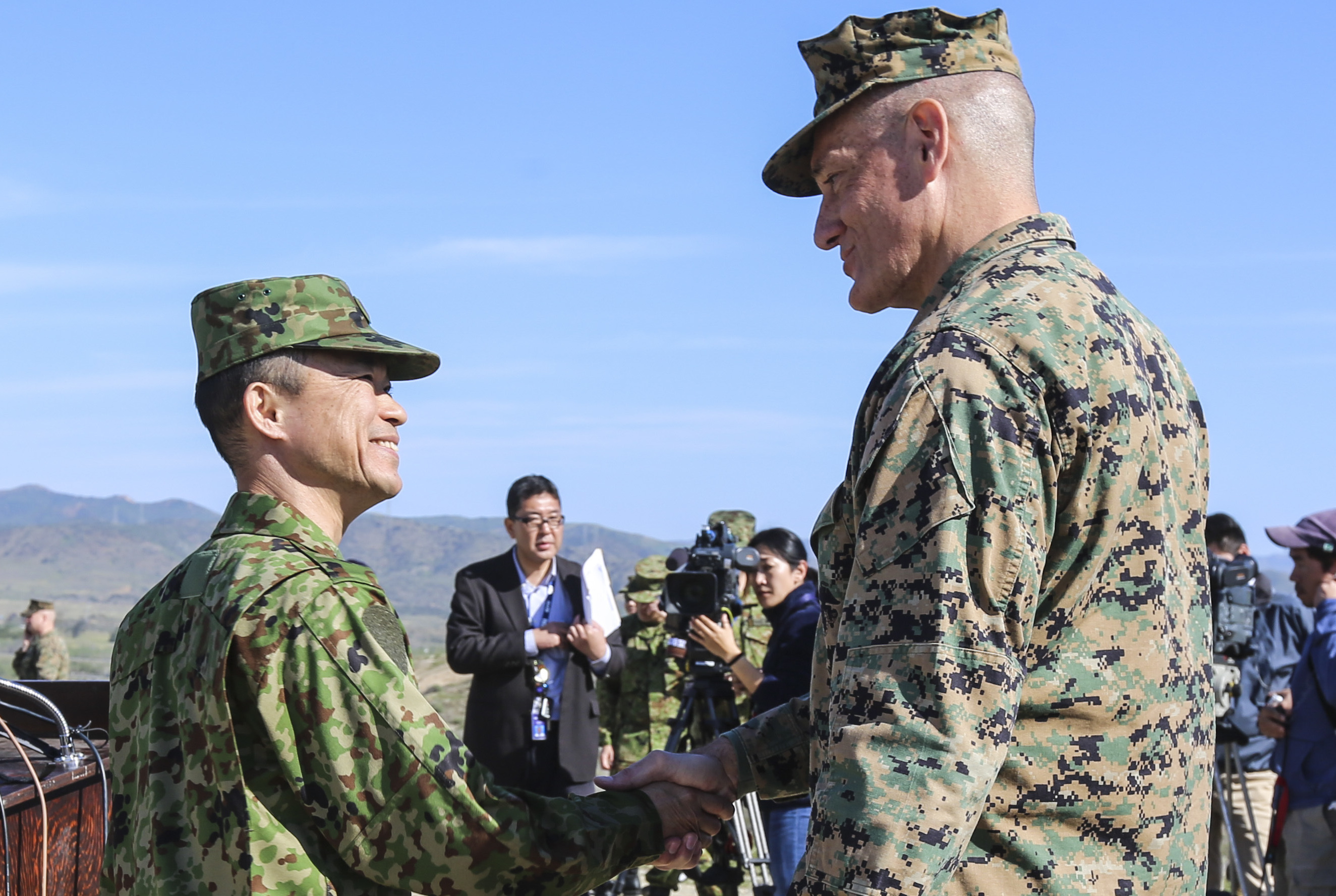 Brig. Gen. David Coffman, deputy commanding general, I Marine Expeditionary Force, shakes hands with Maj. Gen. Shinichi Aoki, deputy chief of staff (operations), Western Army, Japan Ground Self-Defense Force. US Marine Corps Photo