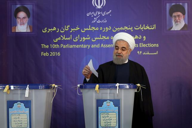 Iranian President Hassan Rouhani casts his vote during elections for the parliament and Assembly of Experts, which has the power to appoint and dismiss the supreme leader, in Tehran Feb. 26, 2016. Iranian Government Photo