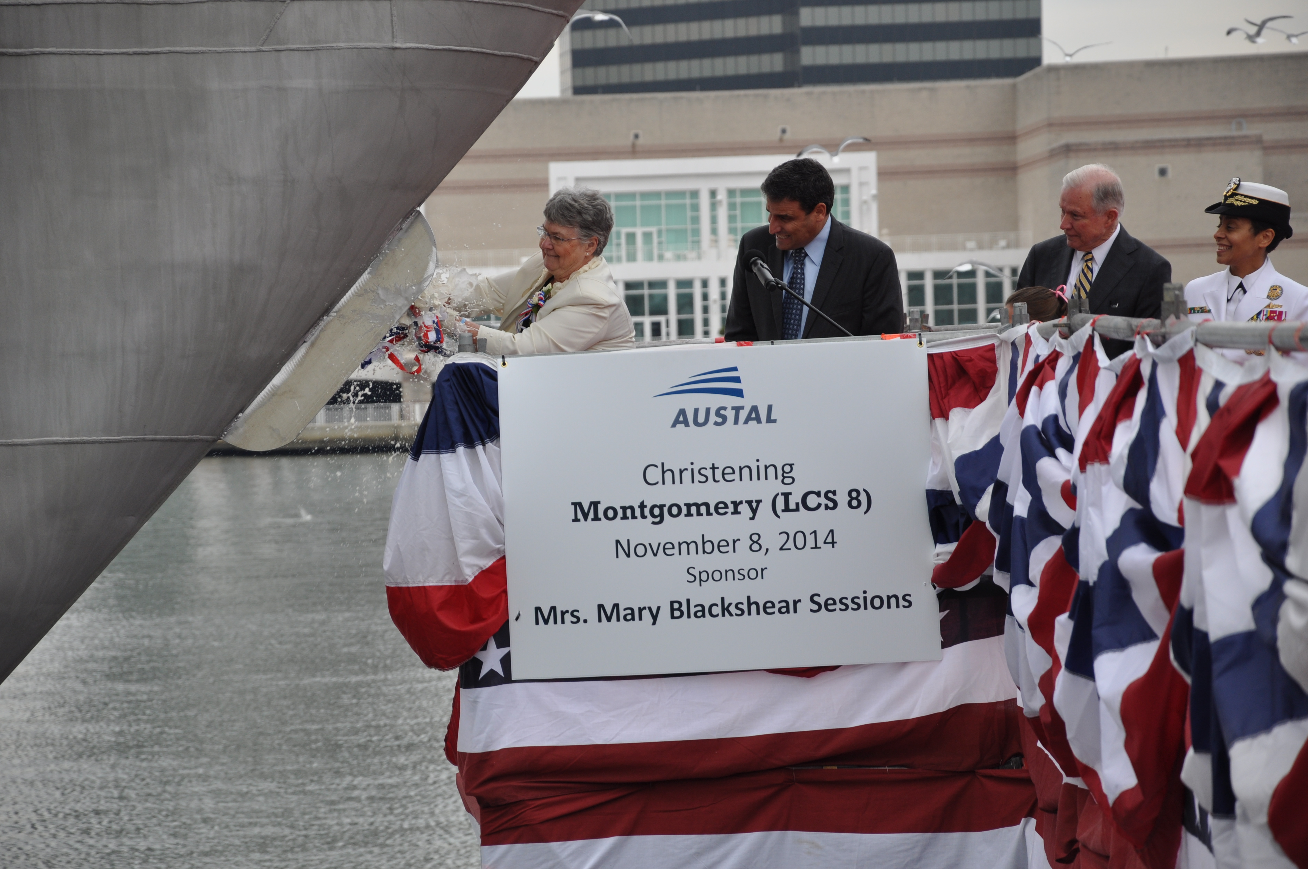 Mary Blackshear Sessions christens the littoral combat ship Pre-Commissioning Unit (PCU) Montgomery (LCS 8) at the Austal USA shipyard in Mobile, Ala., on Nov. 8, 2014. US Navy photo.