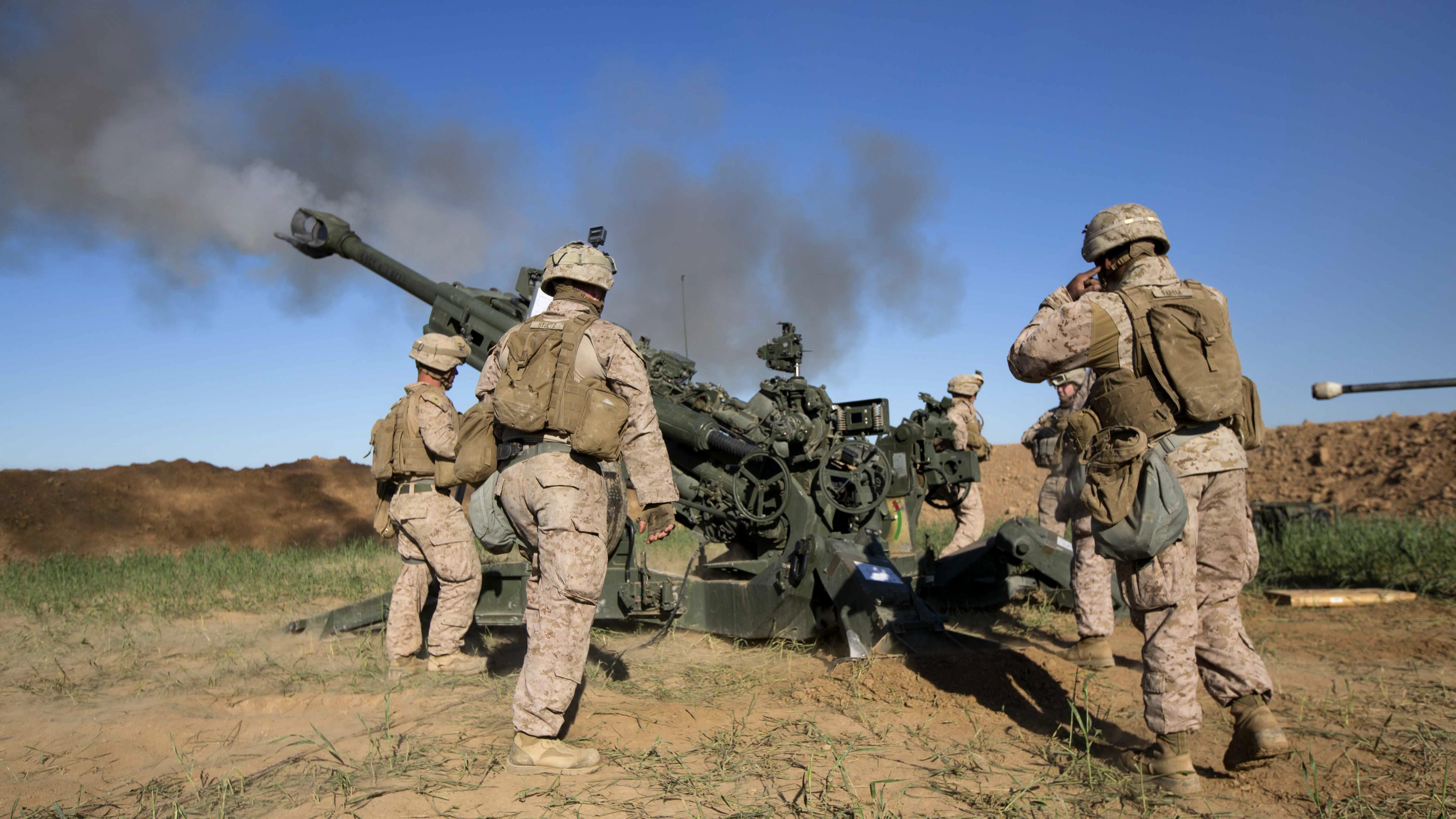 U.S. Marines with Task Force Spartan, 26th Marine Expeditionary Unit (MEU), on Fire Base Bell, Iraq, fire an M777A2 Howitzer at an ISIS infiltration route March 18, 2016. US Marine Corps Photo