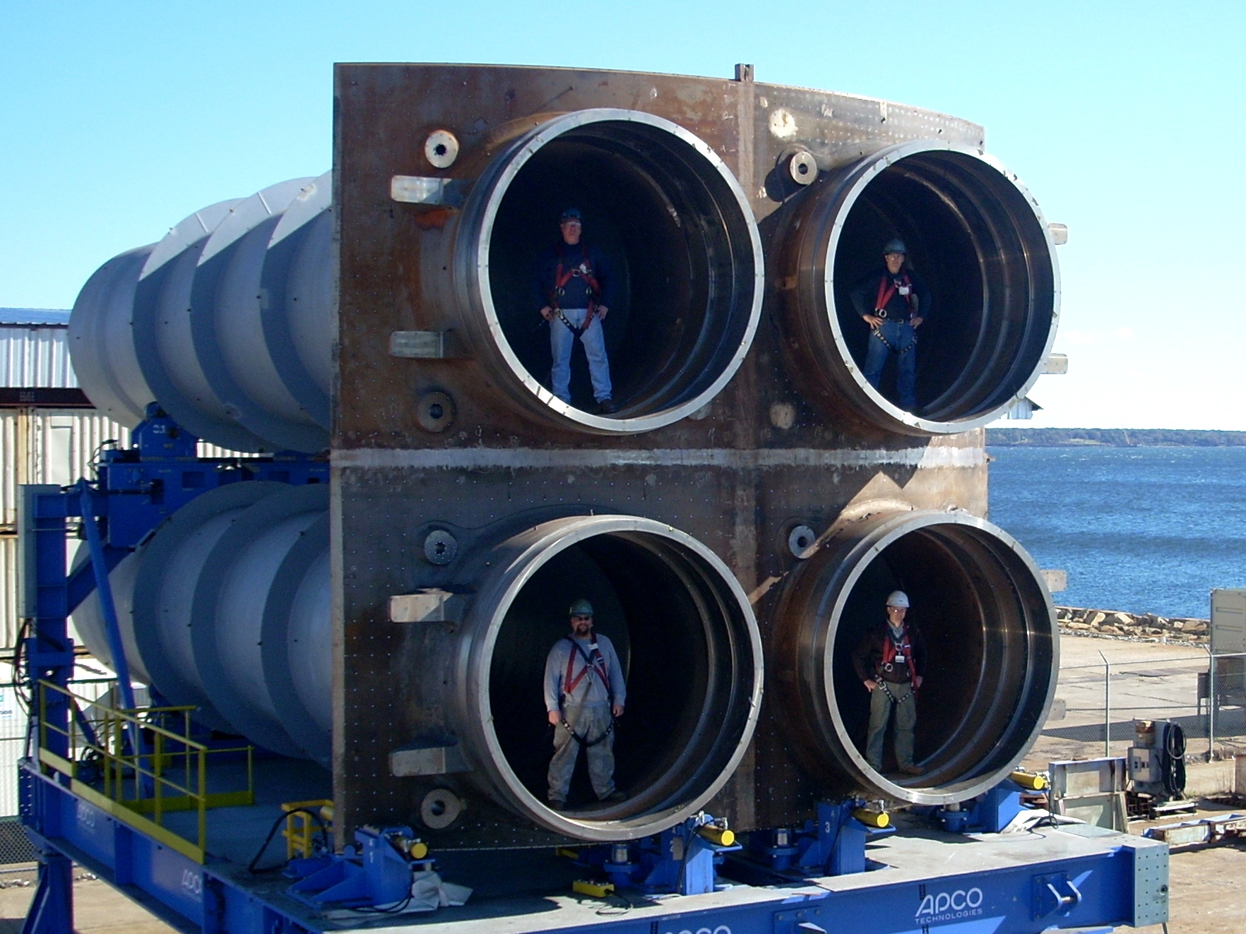 "Workers stand pose for a photo in the four-tube ""quad-pack"" built for the U.S. Ohio Replacement-class and U.K. Successor-class. General Dynamics Electric Boat Photo via US Navy"