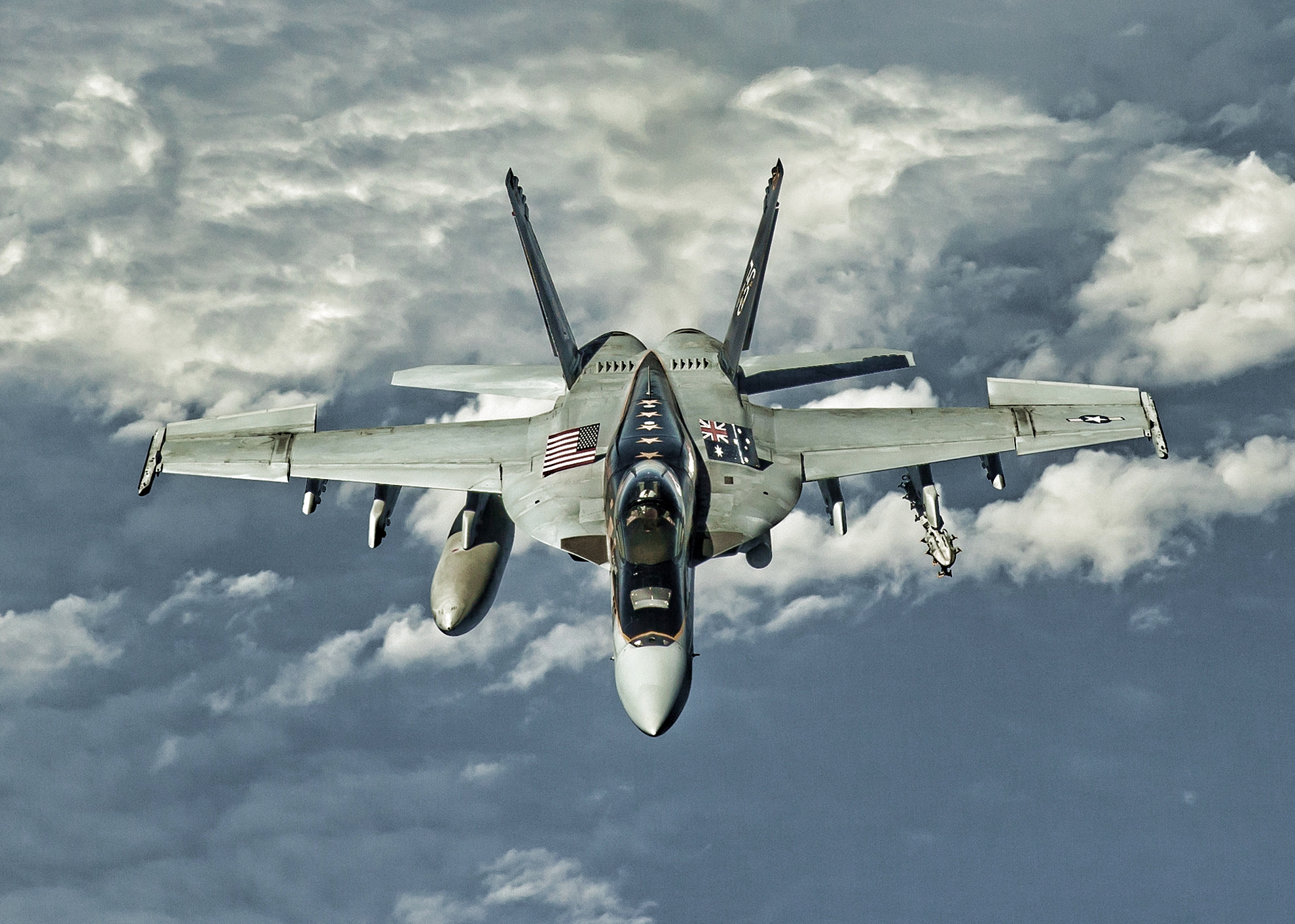 "An F/A-18E Super Hornet assigned to the ""Eagles"" of Strike Fighter Squadron (VFA) 115 transits the Bismarck Sea in March 2016 en route to Royal Australian Air Force (RAAF) Base Townsville, Queensland, Australia. VFA-115 is conducting bilateral operations with the RAAF as part of Exercise Black Dagger. US Navy photo."