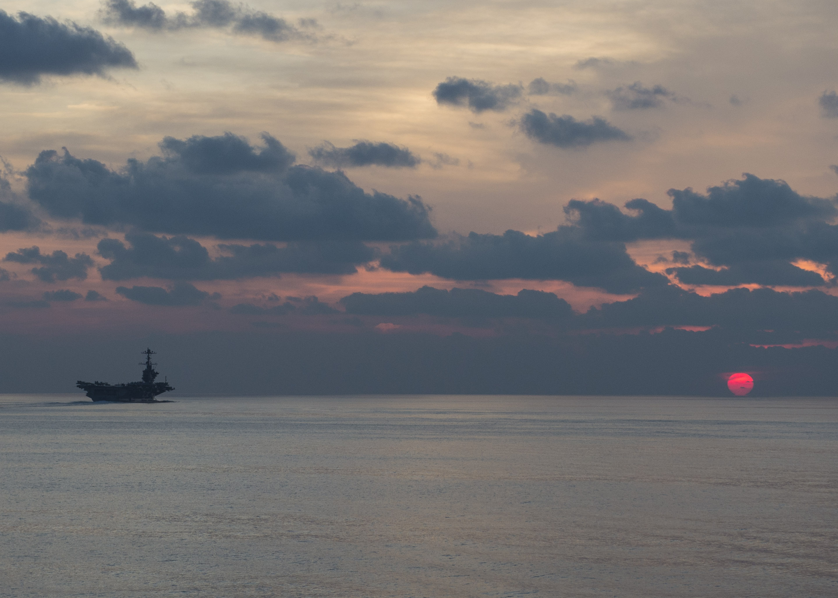 USS John C. Stennis (CVN-74) steams at dusk in the South China Sea on April 25, 2016. US Navy Photo