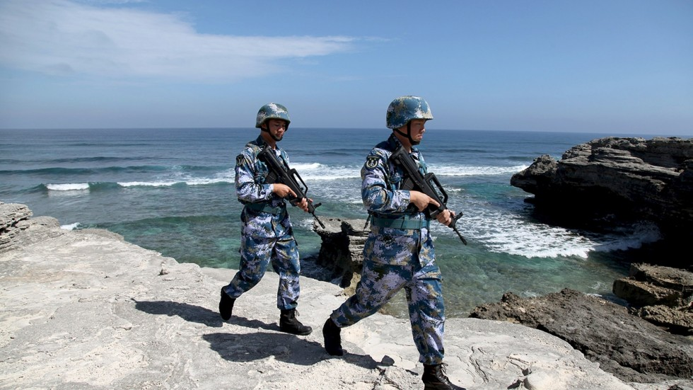 People's Liberation Army troops patrol an island in the South China Sea. PLA Photo