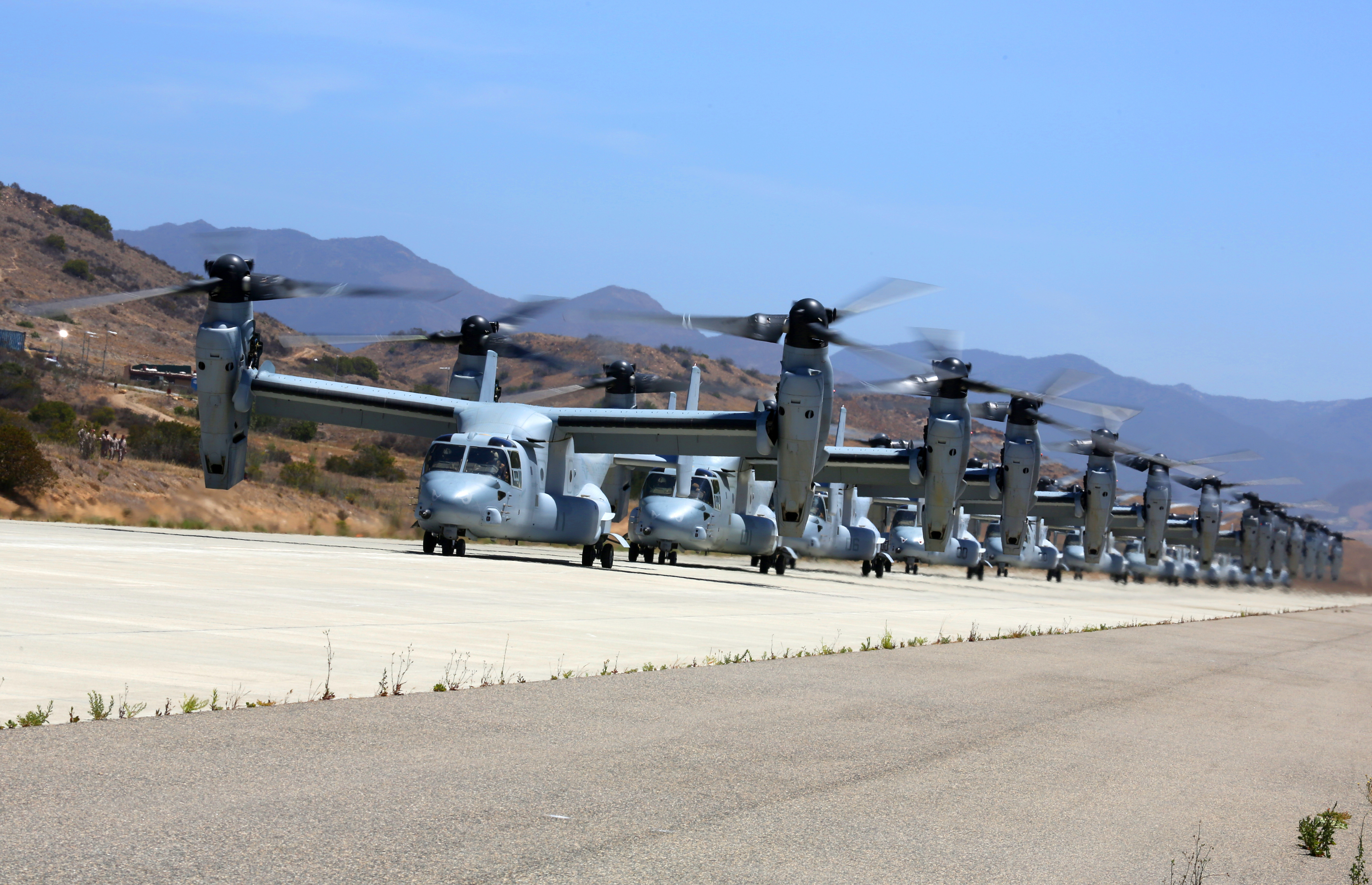 MV-22B Ospreys with Marine Medium Tiltrotor Squadron 163, 3rd Marine Aircraft Wing wait to take off to take a battalion of Marines to 29 Palms during Dawn Blitz 2013. US Marine Corps photo.