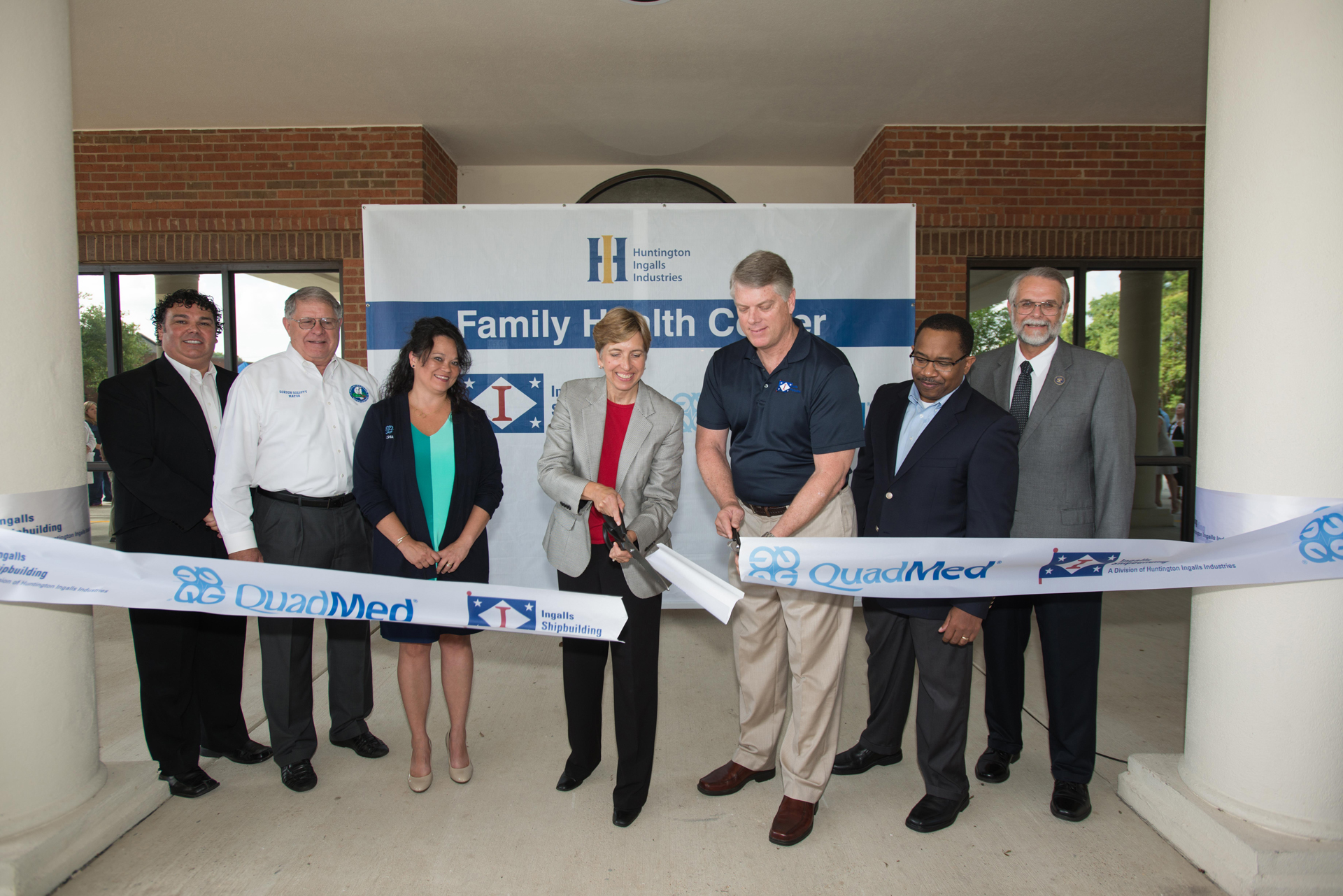 QuadMed President Sue Buettner and Ingalls Shipbuilding President Brian Cuccias cut the ribbon to the HII Family Health Center in Gautier, Miss., on July 1, 2015. Huntington Ingalls Industries photo.