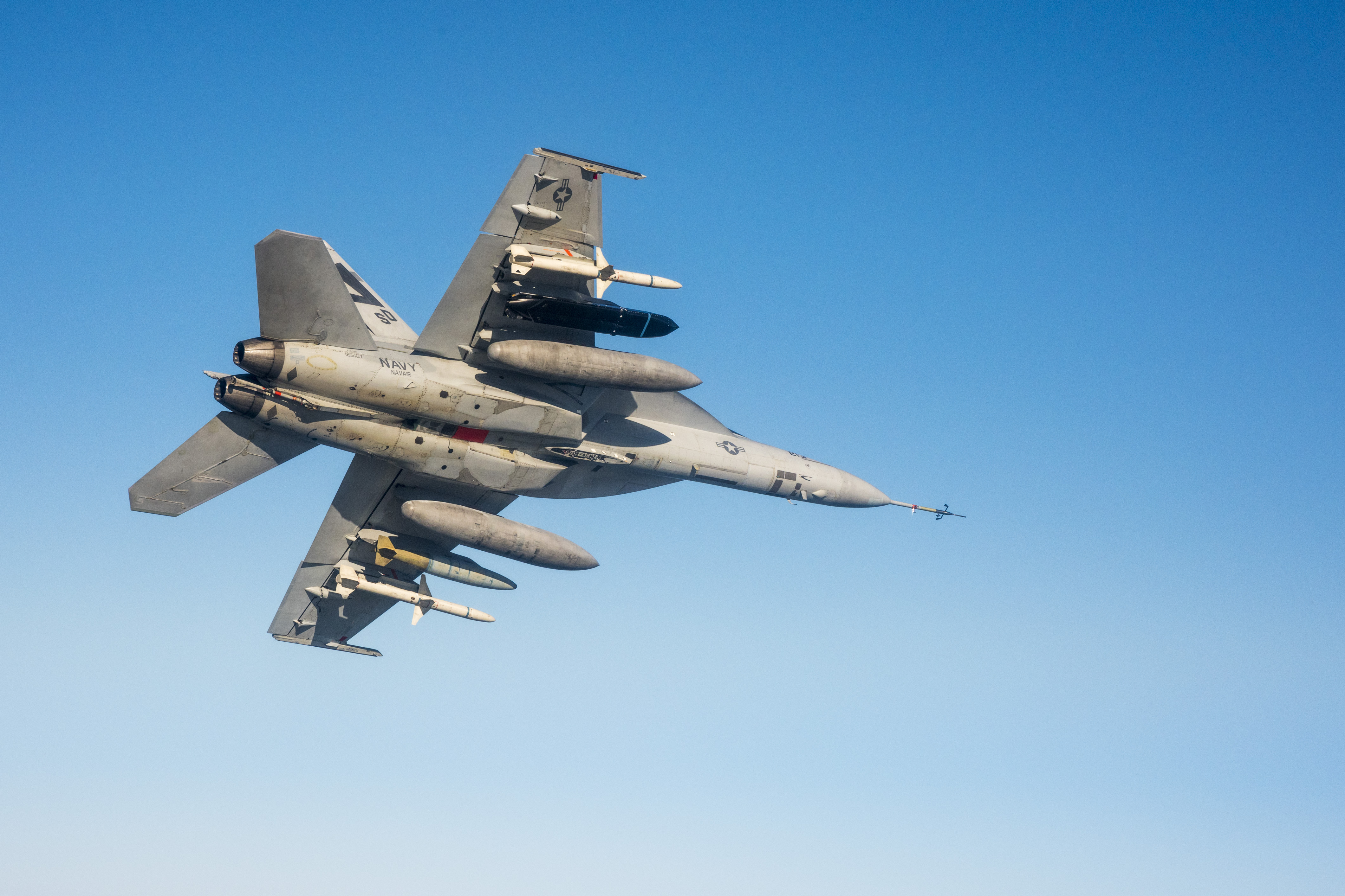 A F/A-18E flying with a black LRASM missile. Lockheed Martin Photo