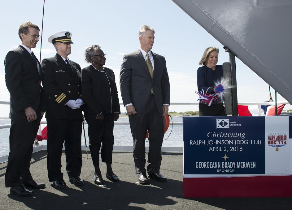 Ship Sponsor Georgeann McRaven christens DDG 114, the destroyer named for Medal of Honor recipient Ralph Johnson. Also pictured (left to right) are Assistant Secretary of the Navy Sean Stackley; Cmdr. Jason Patterson, the ship's prospective commanding officer; Helen Richards, Ralph Johnson's sister; and Ingalls Shipbuilding President Brian Cuccias. Huntington Ingalls Industries photo.
