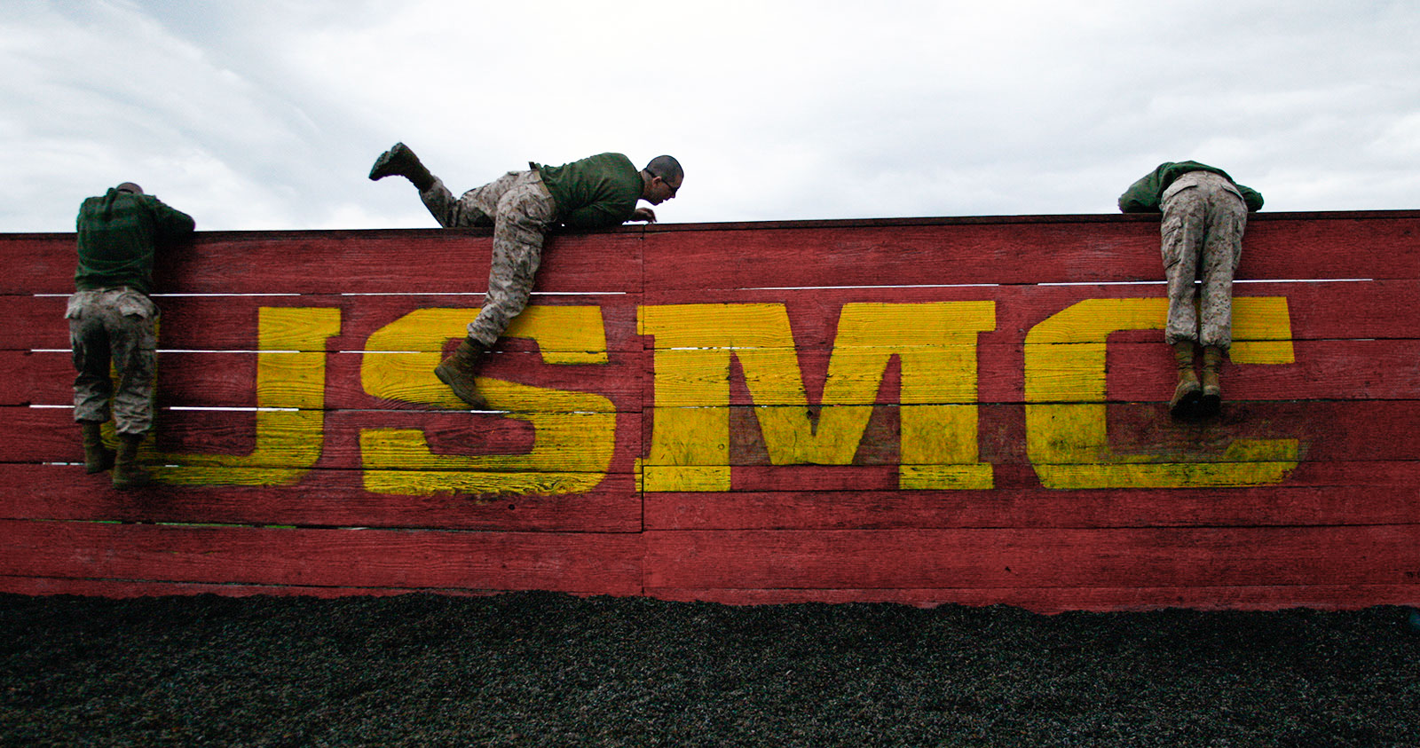 Recruits of Golf Company, 2nd Recruit Training Battalion, climb over a wall during the obstacle course Feb. 25, 2013 on Parris Island. US Marine Corps photo.