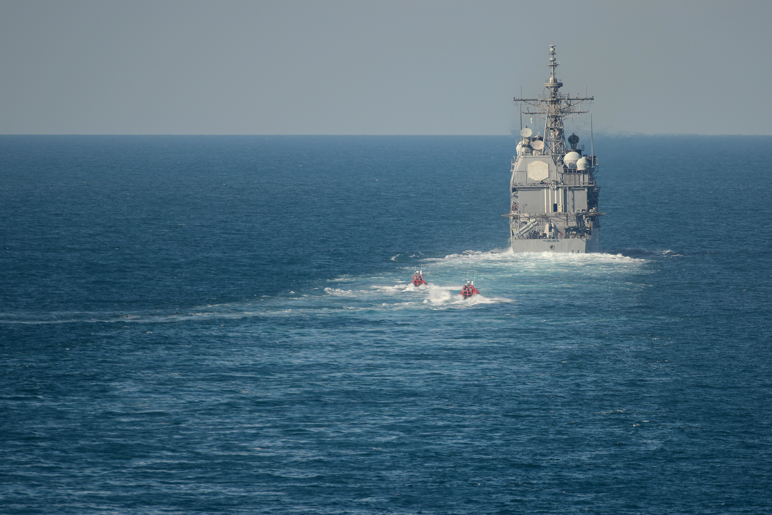 Two fast inbound attack craft approach guided-missile cruiser USS Anzio (CG 68) during a simulated strait transit with the Harry S. Truman Carrier Strike Group. US Navy photo.