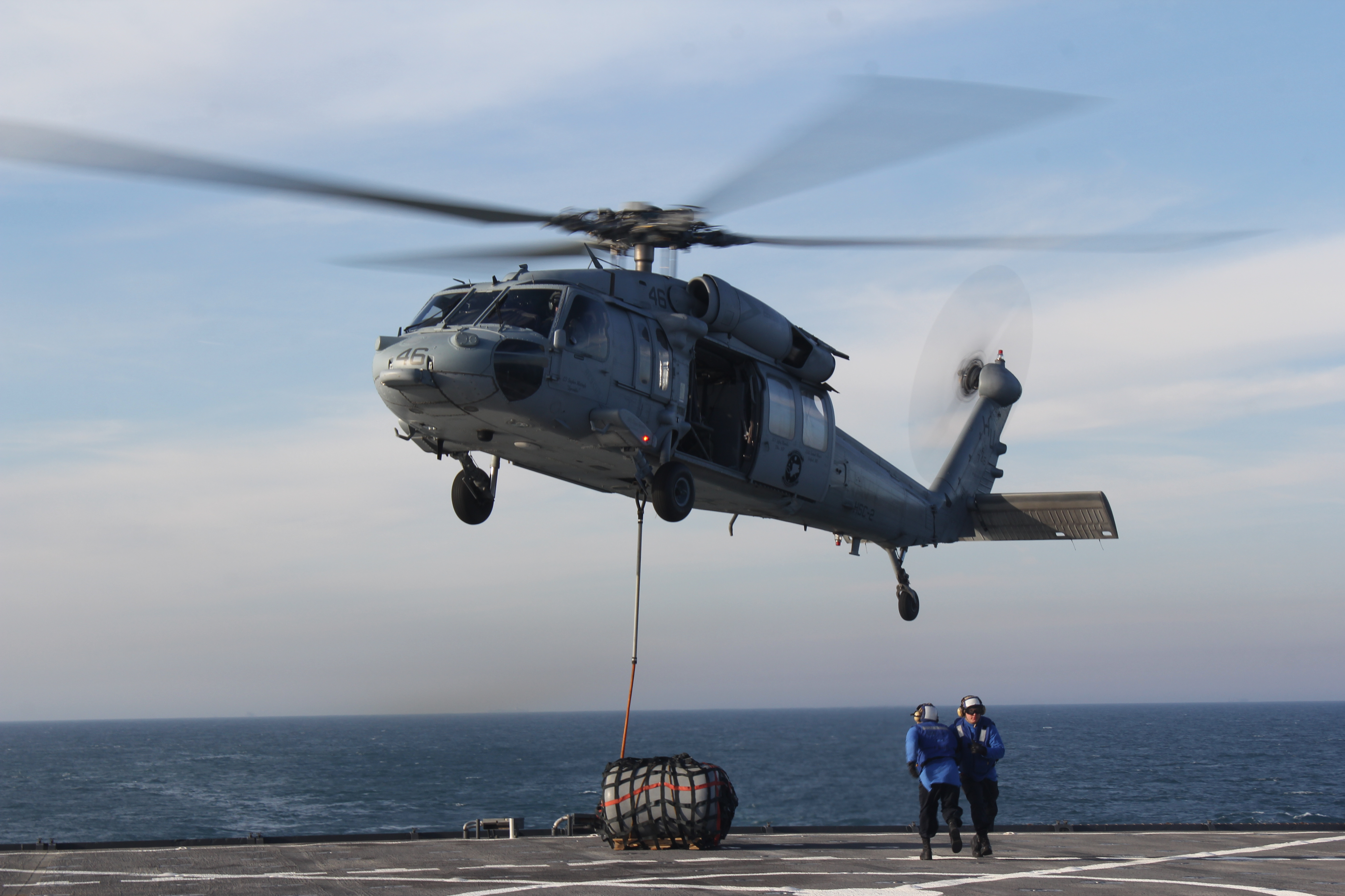 Redhawk 746 from the Fleet Angels of HSC-2 conduct daytime vertical replenishment training for certification onboard the USS Carter Hall (LSD-50) off the cost of Norfolk, Va., on March 7, 2016. US Navy photo.