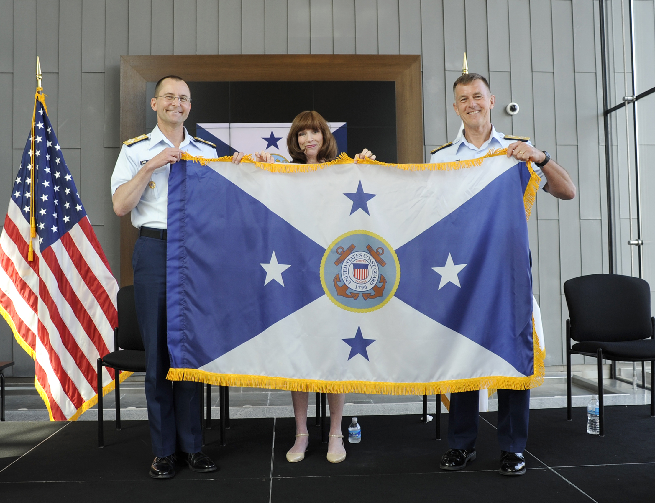 Adm. Paul Zukunft (right), commandant of the Coast Guard, presents the new flag of the vice commandant of the Coast Guard to Adm. Charles Michel at the conclusion of a ceremony at the Douglas Munro Coast Guard Headquarters Building in Washington, D.C., on June 1, 2016. US Coast Guard photo. Following passage of the Coast Guard Authorization Act of 2015, the president nominated Michel for promotion from vice admiral to admiral to align the Coast Guard's leadership structure to that of the other armed services. U.S. Coast Guard photo by Senior Chief Kyle Niemi